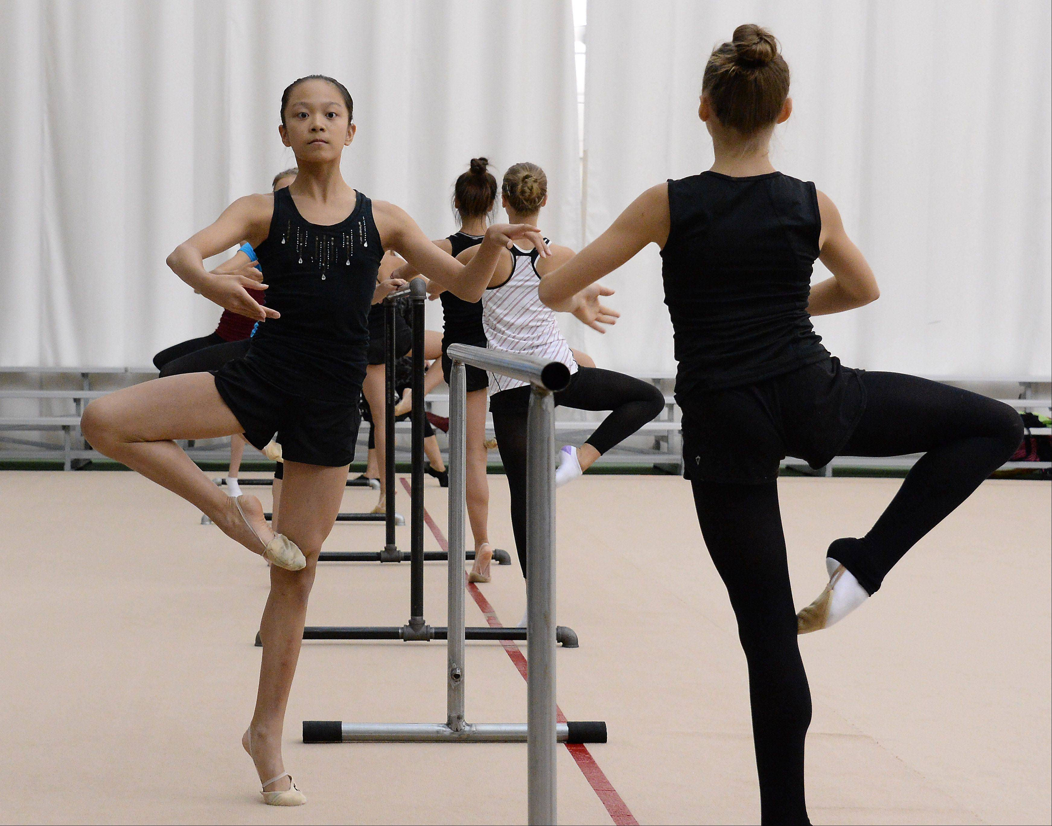 Laura Zeng, 13, left, of Libertyville and Camilla Feeley, 13, of Lincolnshire take a ballet lesson during a recent training session at the North Shore Rhythmic Gymnastic Center in Deerfield. Both are members of the junior national team and Laura is the reigning national champion.