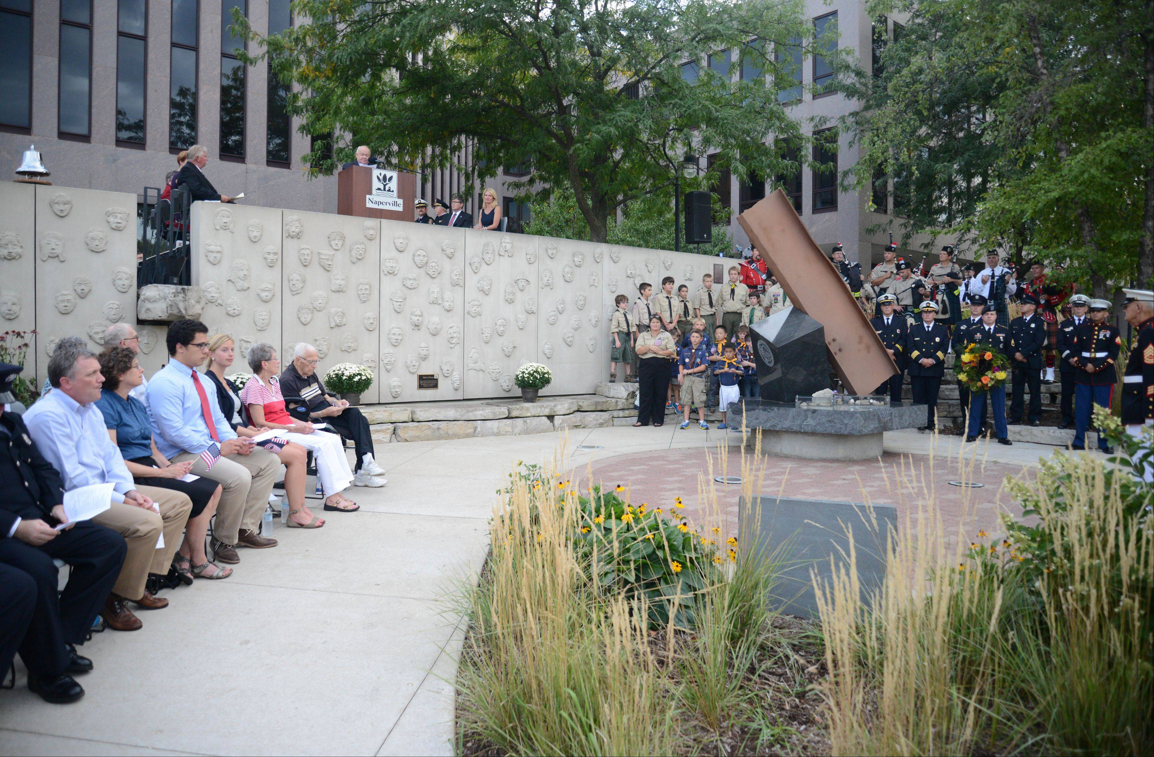 A crowd of a few hundred gathered on both sides of the DuPage River at the Cmdr. Dan Shanower Memorial in Naperville to mark the 12th anniversary of the Sept. 11 terrorist attacks and honor those who lost their lives that day.