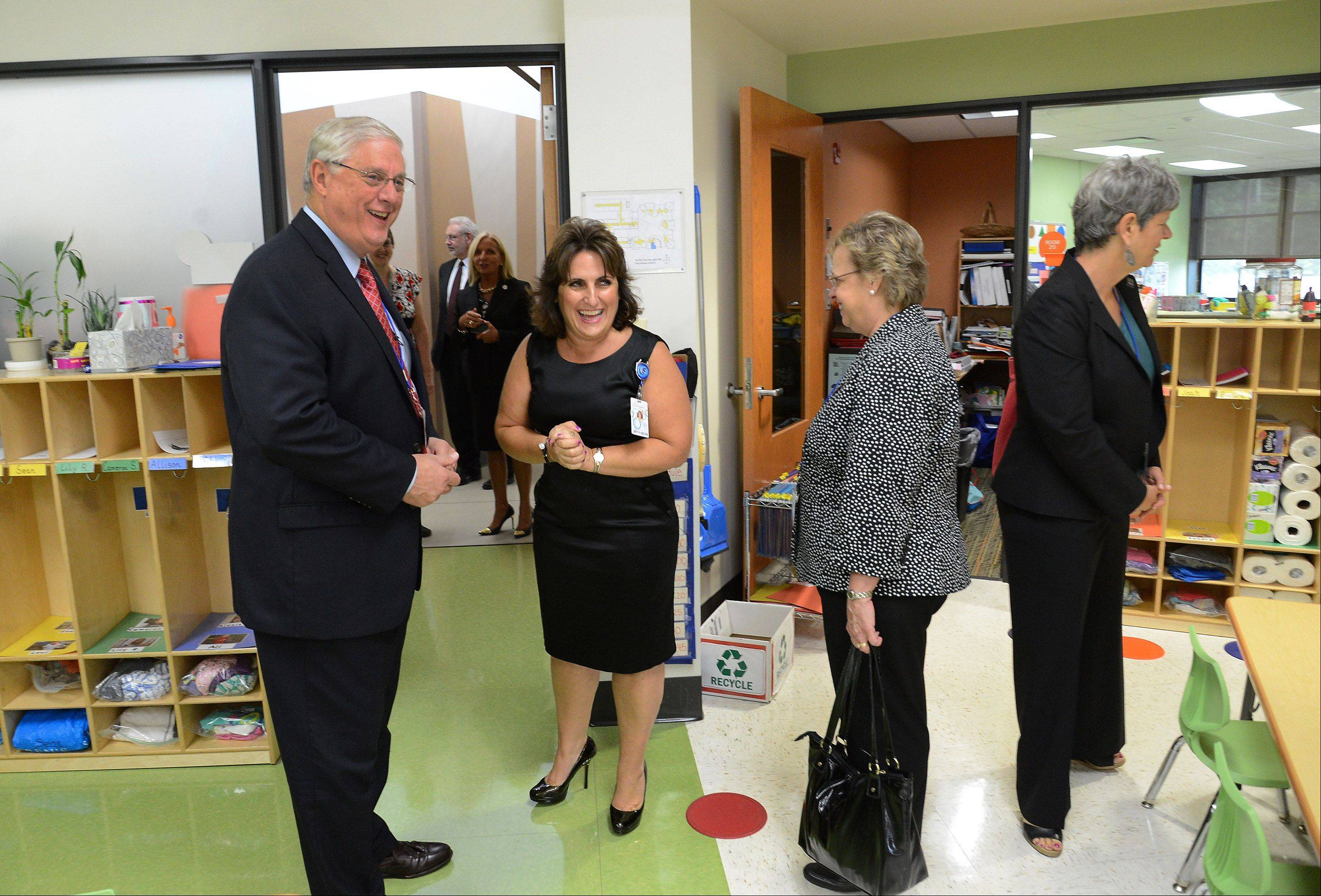 Margie Beniaris, director of Early Learning Center, gives Dennis Van Roekel, president of the National Education Association, a tour of one of the classrooms of the Early Learning Childhood Center at Forest Elementary School in Des Plaines.