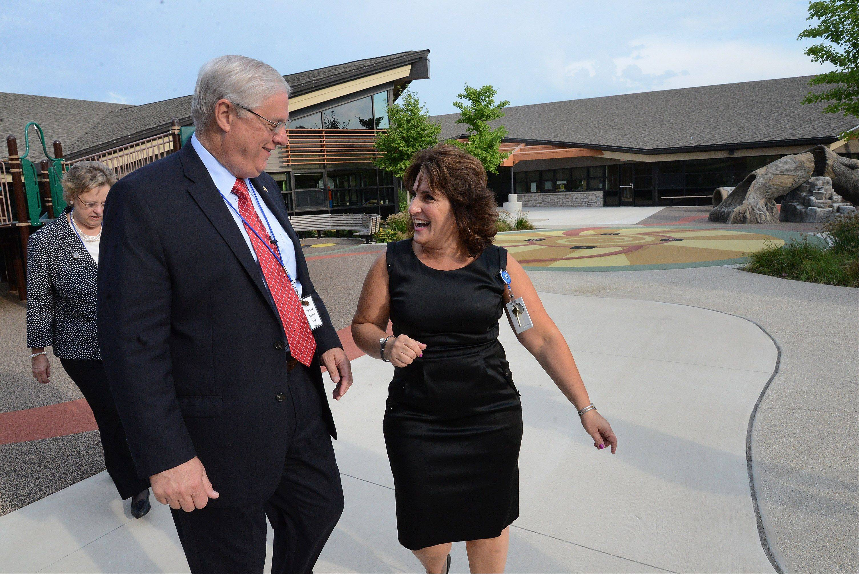 Margie Beniaris, director of Early Learning Center, gives Dennis Van Roekel, president of the National Education Association, a tour of the outside of the Early Learning Childhood Center at Forest Elementary School in Des Plaines.