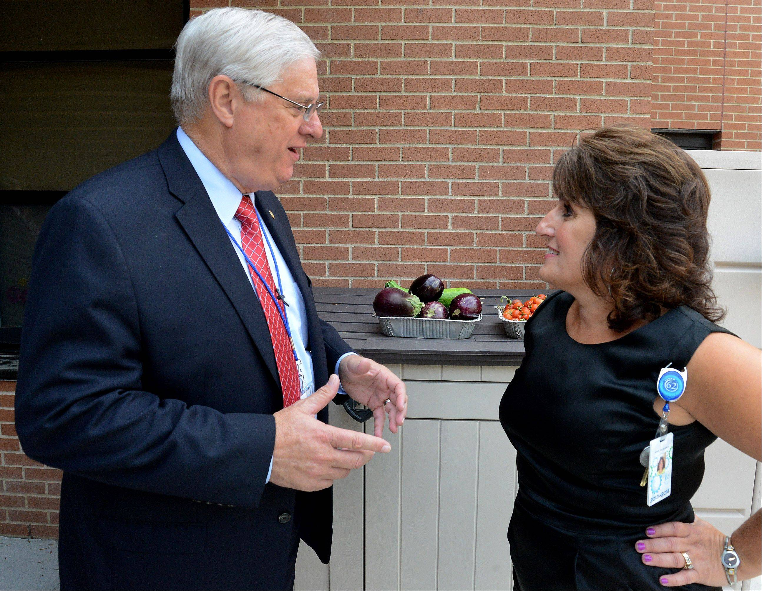 Margie Beniaris, director of Early Learning Center, talks about the vegetables the children grow in their garden to Dennis Van Roekel, president of the National Education Association, during a tour of the Early Learning Childhood Center at Forest Elementary School in Des Plaines.