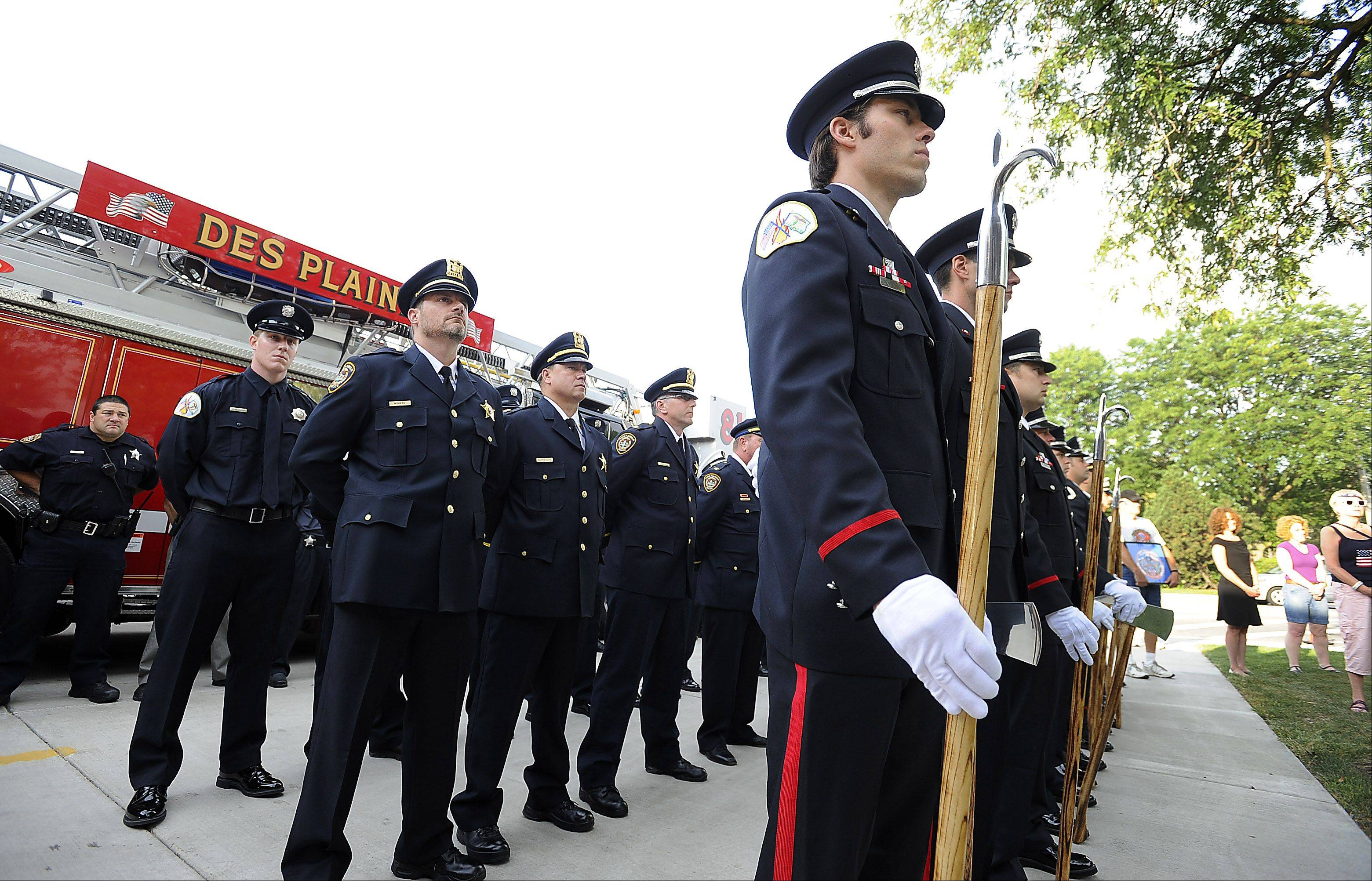 Eric Zack of the Des Plaines Fire Department stands at attention with others from the fire and police departments as the colors are raised at the Sept. 11 memorial and Patriot Day ceremony at fire station 1 on Wednesday.