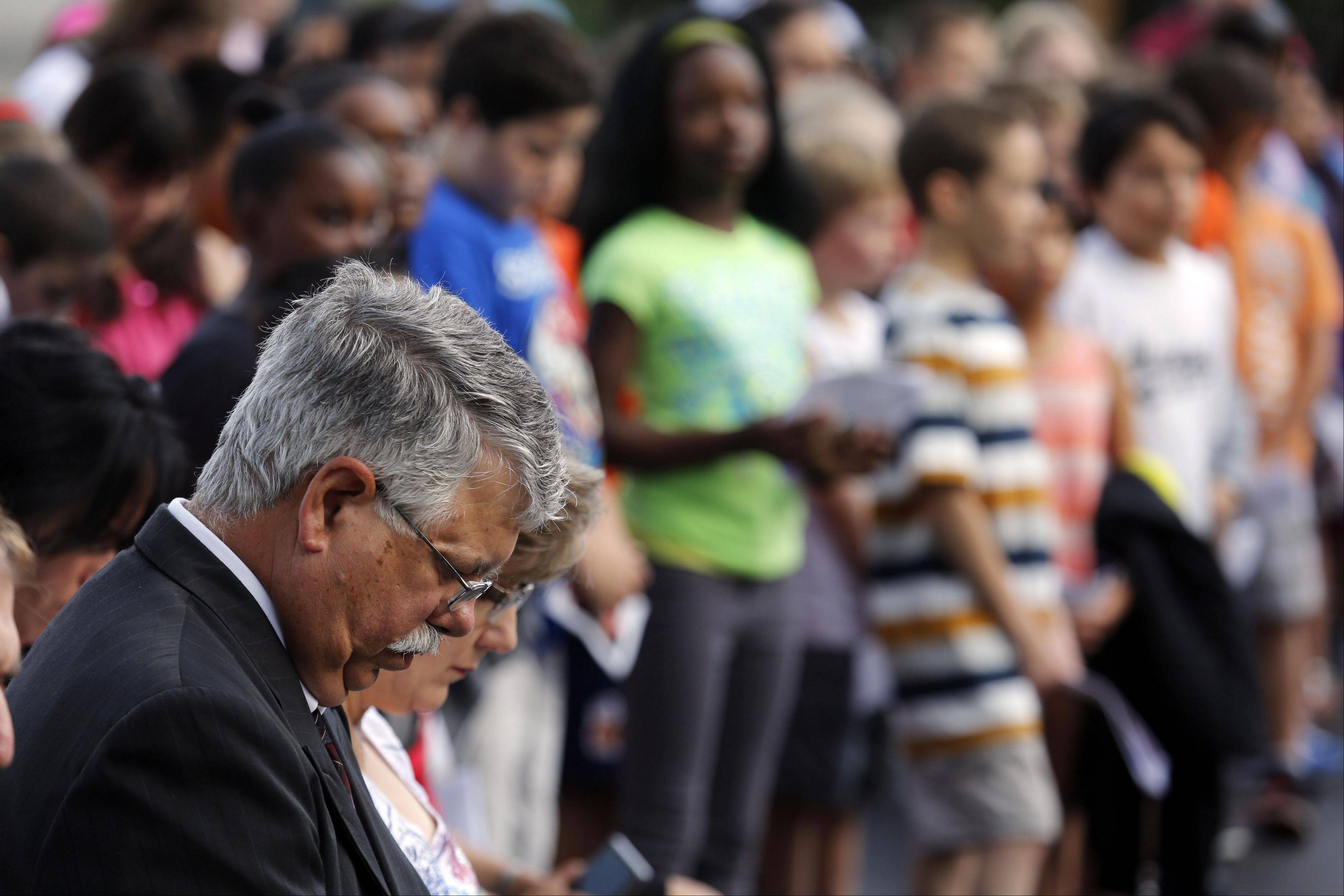Carpentersville Village President Ed Ritter, reflects during prayer at the Sept. 11 ceremony Wednesday at Carpentersville Fire Station 1.