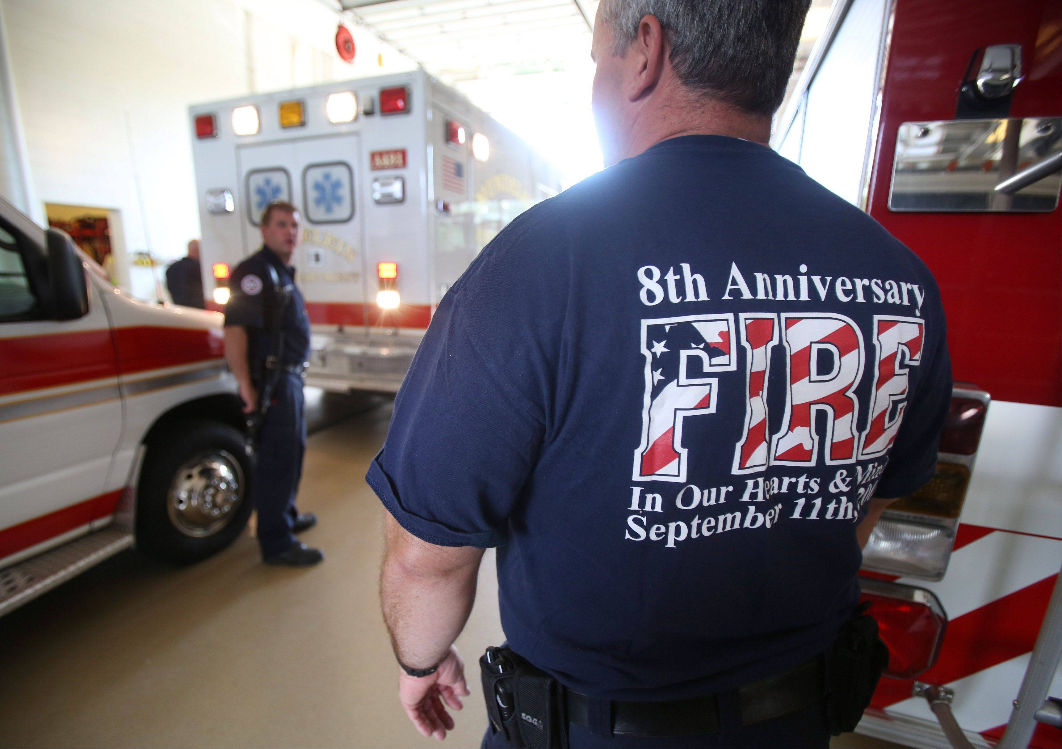 Lt. Bill Lark joins other firefighters with the Mundelein Fire Department as they wear FDNY T-shirts in remembrance of Sept. 11 Wednesday at the Midlothian fire station.
