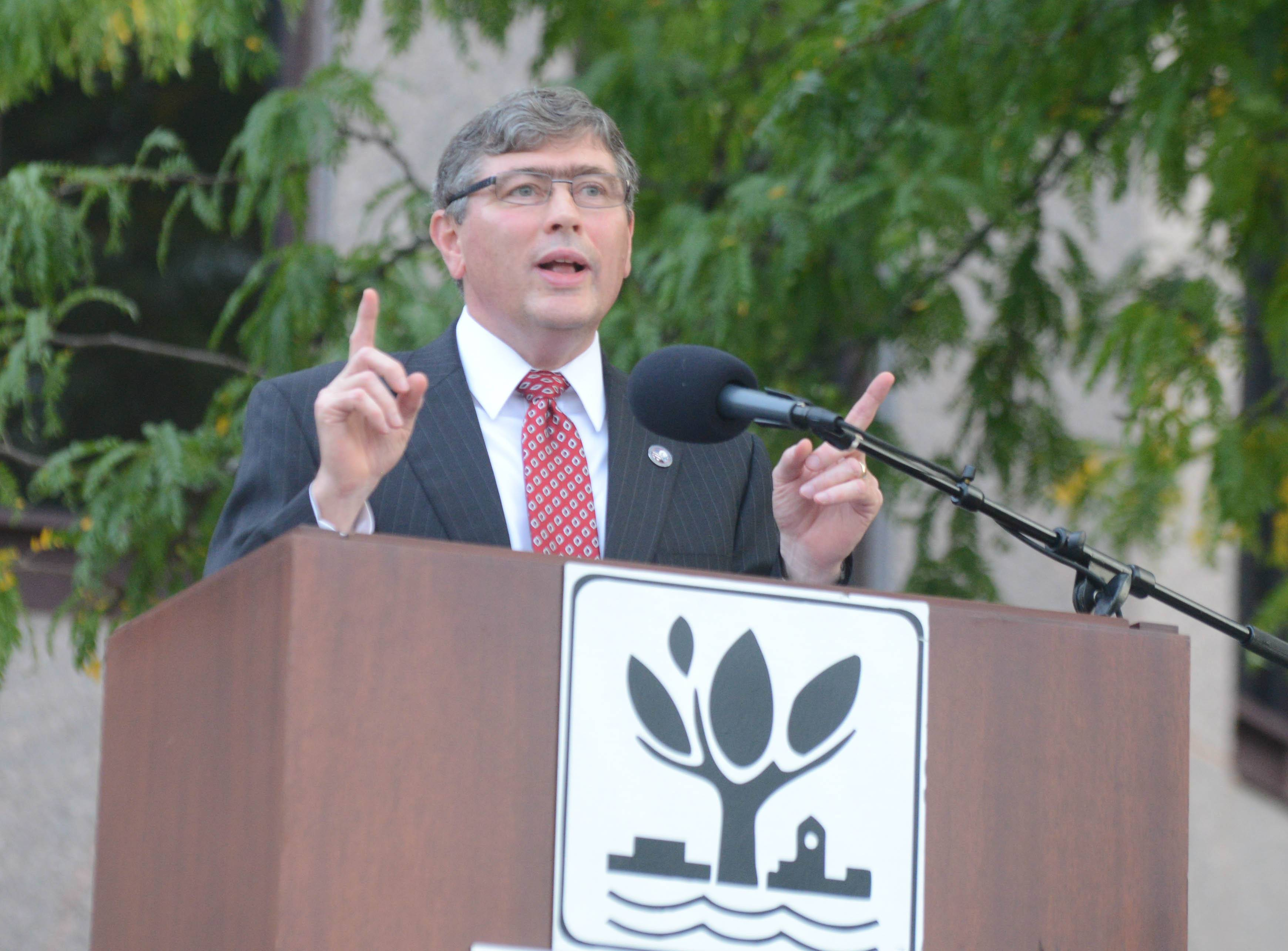 Roger Burgess speaks during the September 11th memorial service in Naperville Wednesday.