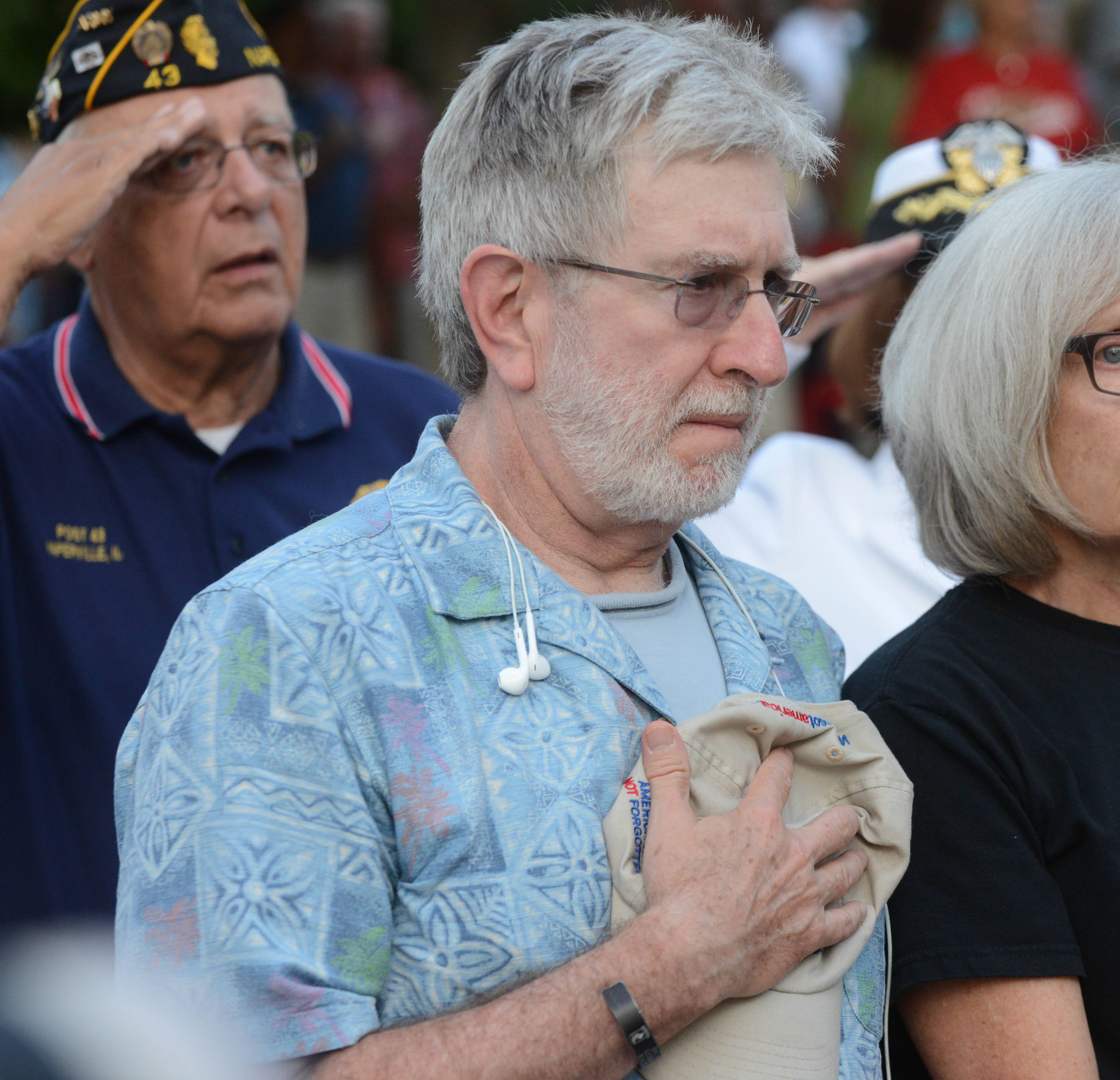 Andy Weiss of Naperville pauses during the Pledge of Allegiance Wednesday at the September 11th memorial service in Naperville.