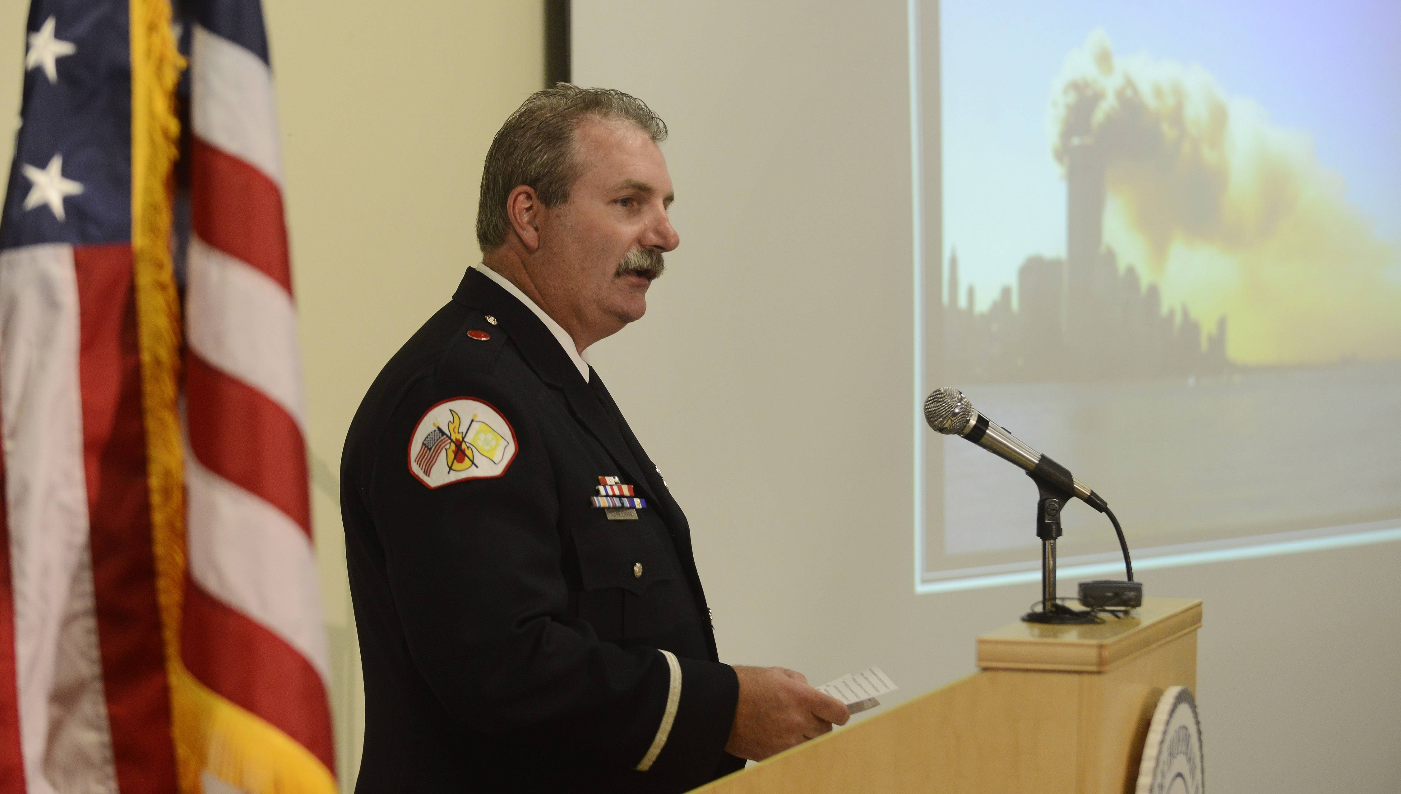 Special guest speaker Lt. John Schneidwind of the Schaumburg Fire Department talks about his experiences at Ground Zero in the days following the September 11, 2001 terrorist attacks, during the Village of Hoffman Estates memorial service held Wednesday evening at the village hall.