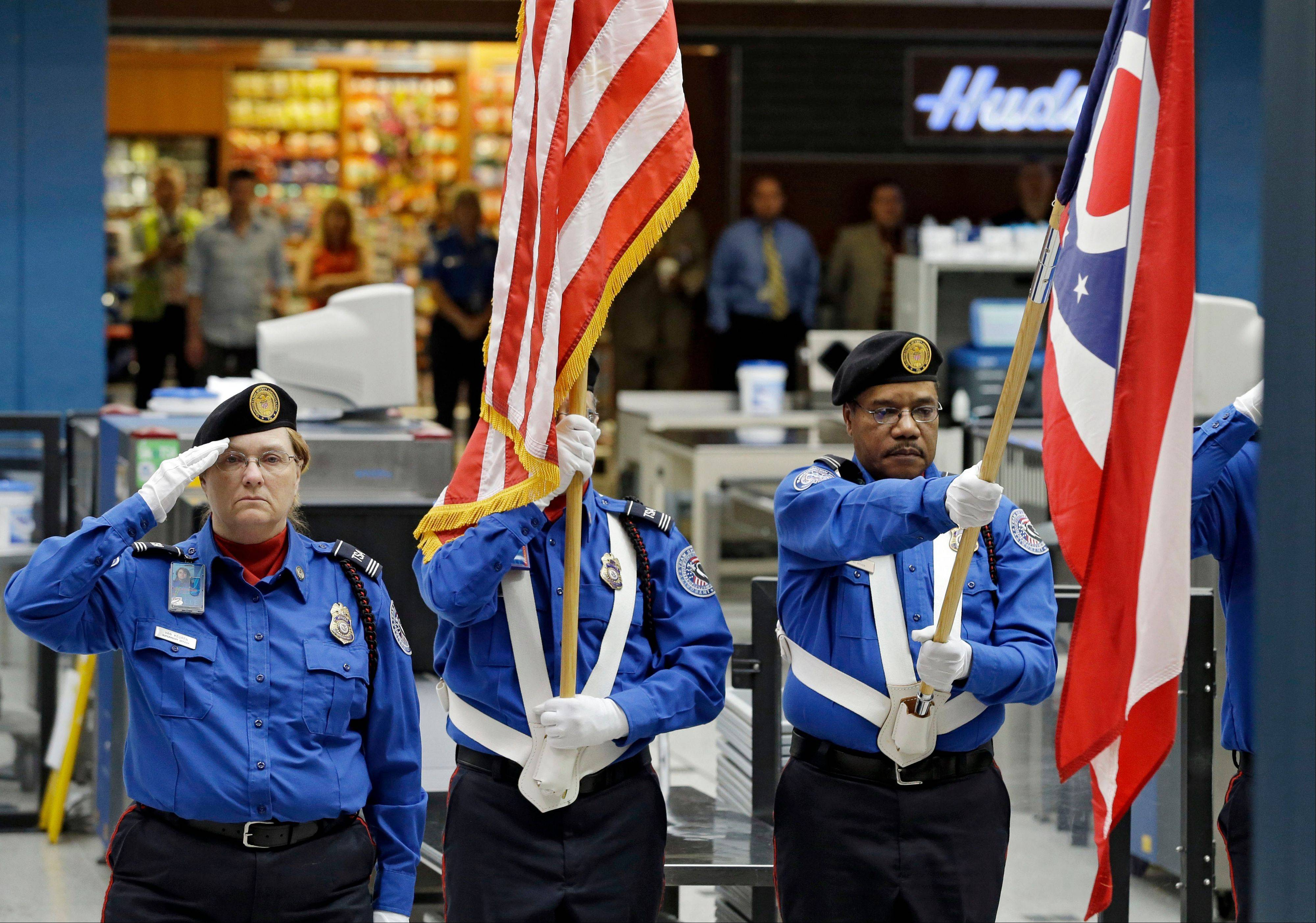 A TSA color guard takes part in a ceremony at Cleveland Hopkins Airport Wednesday, Sept. 11, 2013, marking the 12th anniversary of the 9/11 terror attacks.