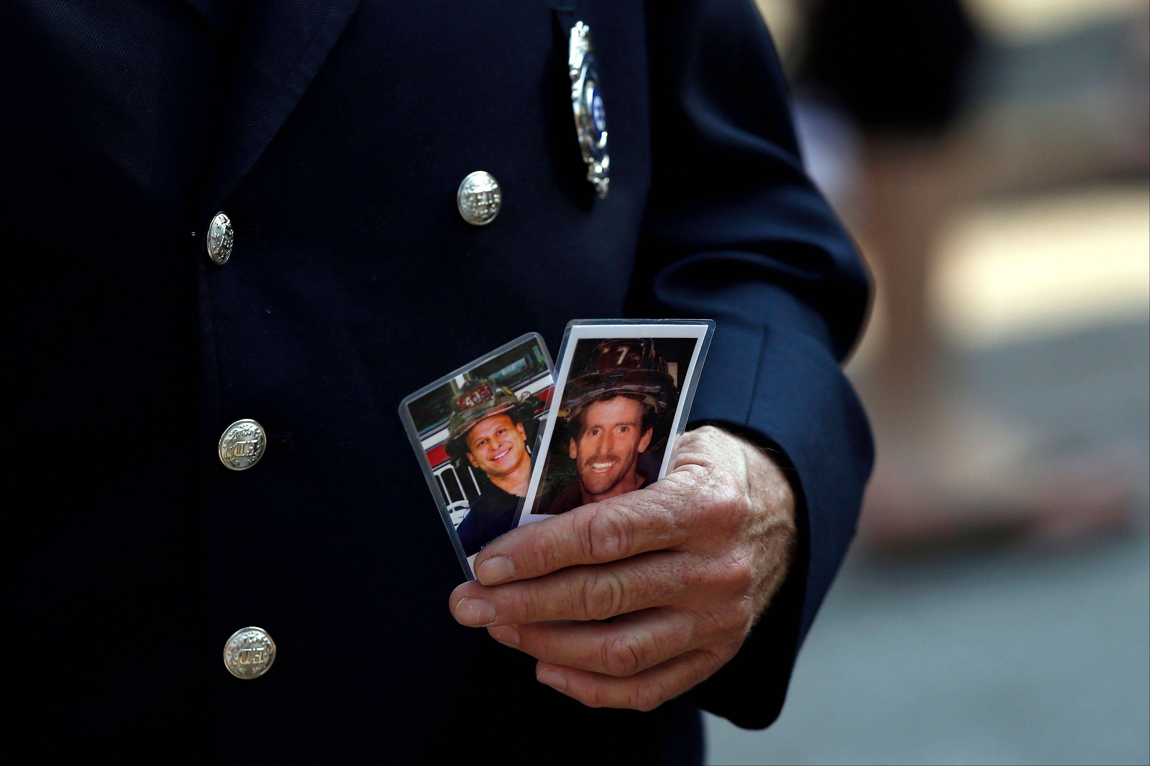 Friends and relatives of the victims of the 9/11 terrorist attacks gather at the National September 11 Memorial at the World Trade Center site, Wednesday, Sept. 11, 2013, for a ceremony marking the 12th anniversary of the attacks in New York.