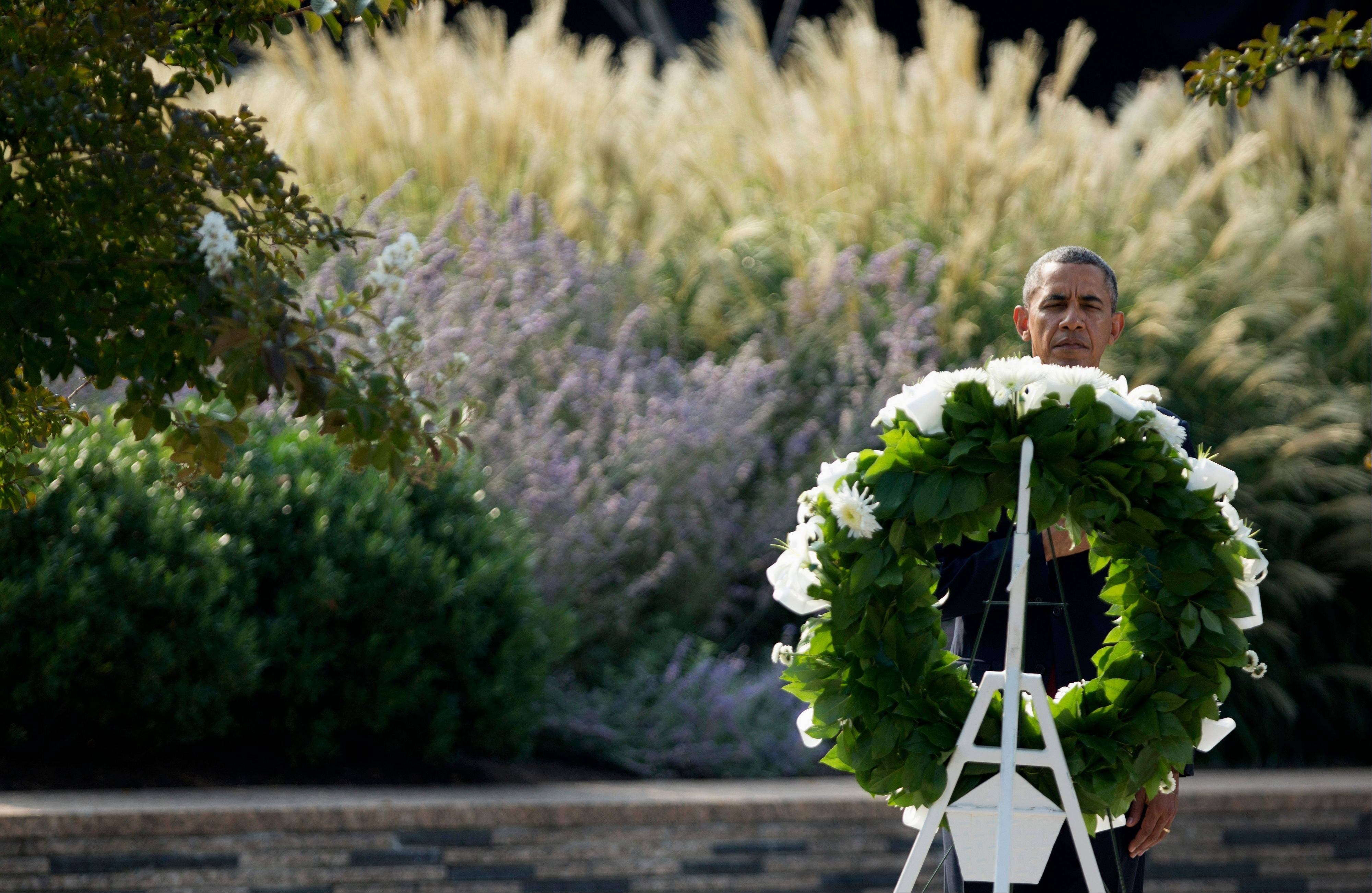 President Barack Obama lays a wreath at the Pentagon, Wednesday, Sept. 11, 2013, during a ceremony marking the 12th anniversary of the worst terror attack on the US. The Pentagon was struck by one of the hijacked plane.