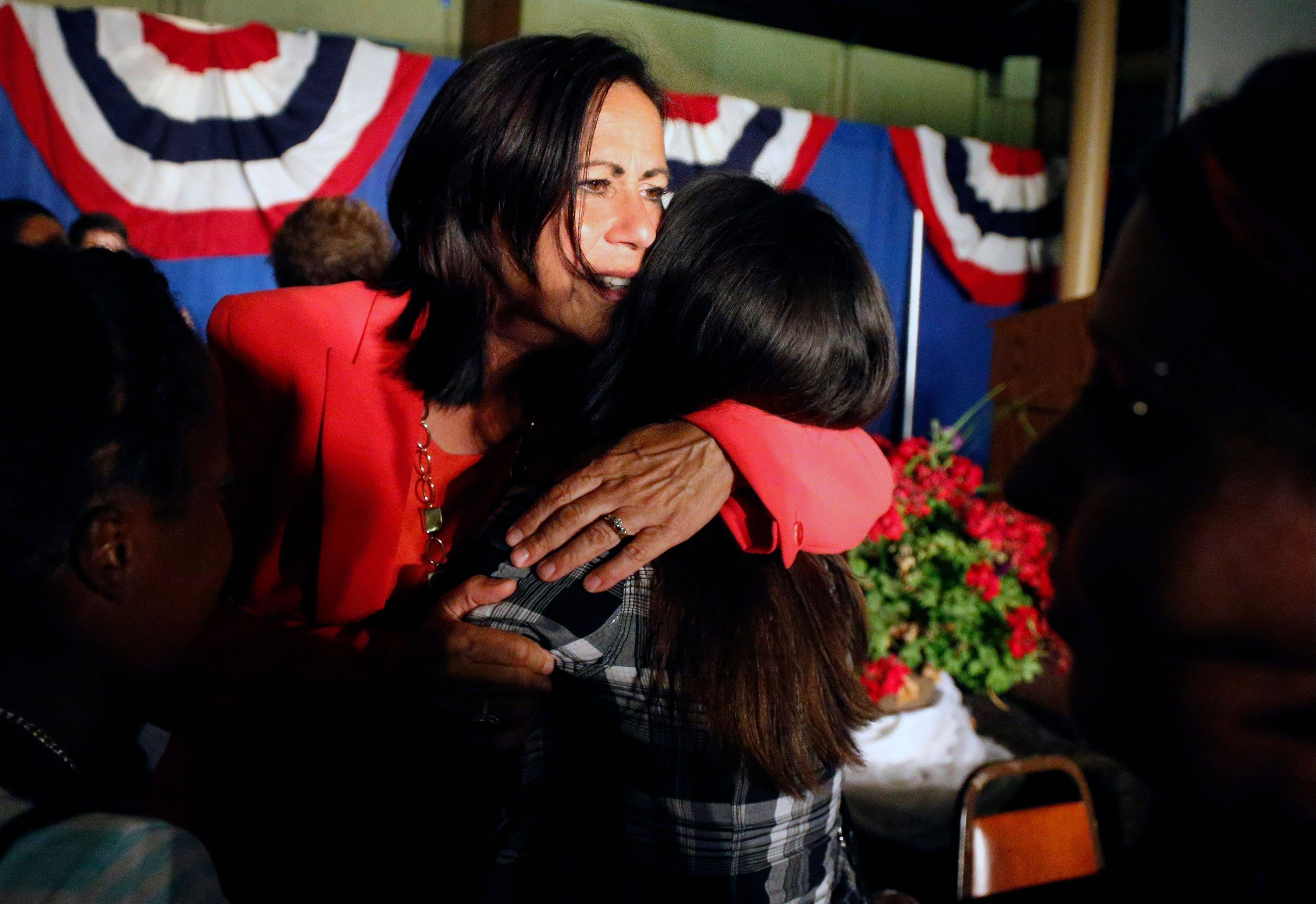 Democratic state Sen. Angela Giron hugs a supporter after giving her concession speech after she lost in a recall vote in Pueblo, Colo., Tuesday Sept. 10, 2013. Two Colorado state lawmakers who backed gun-control measures in the aftermath of the mass shootings in Colorado and Connecticut last year have been ousted in recall elections.
