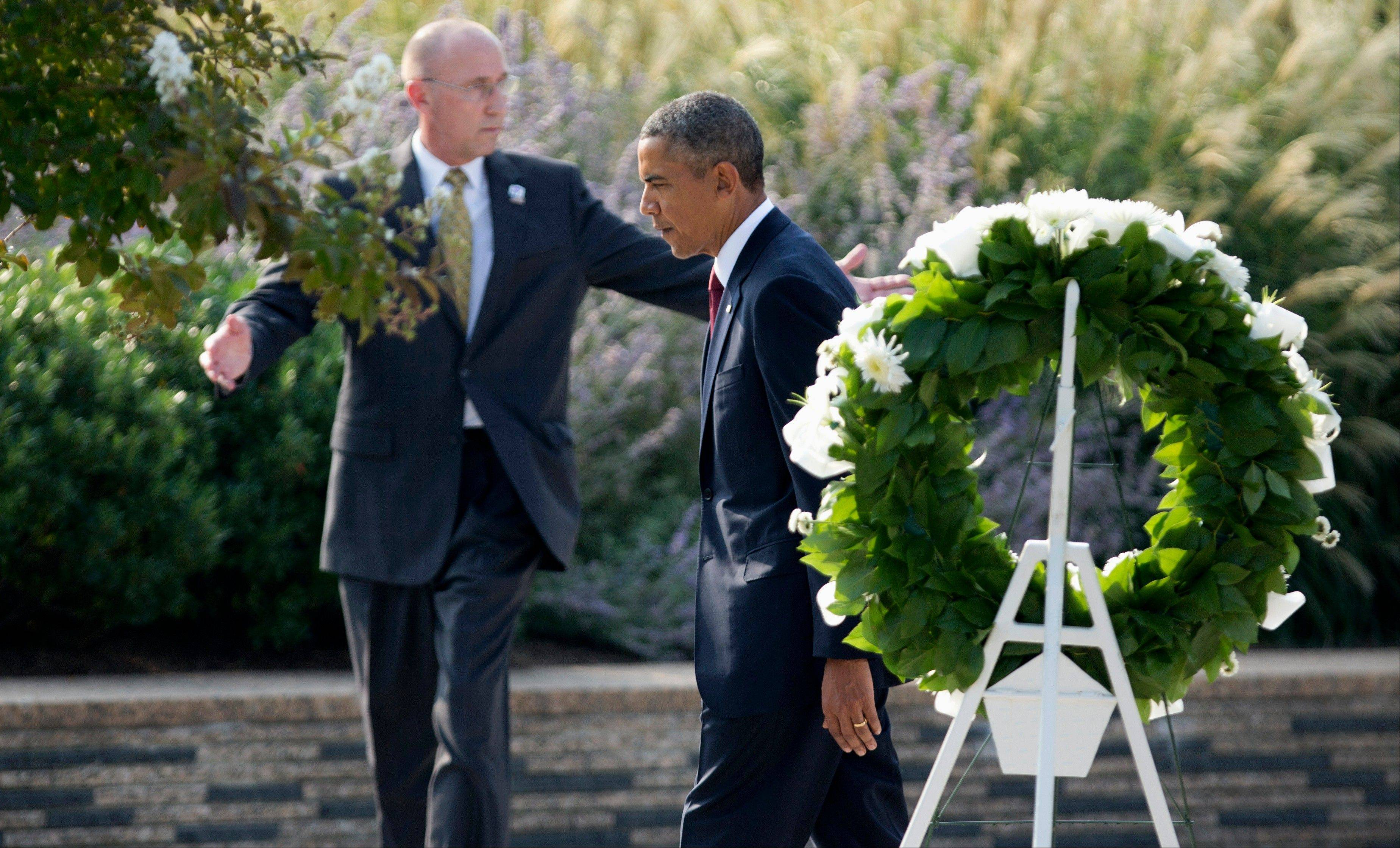 President Barack Obama leaves after laying a wreath at the Pentagon, during a ceremony marking the 12th anniversary of the worst terror attack on the US. The Pentagon was struck by one of the hijacked plane.