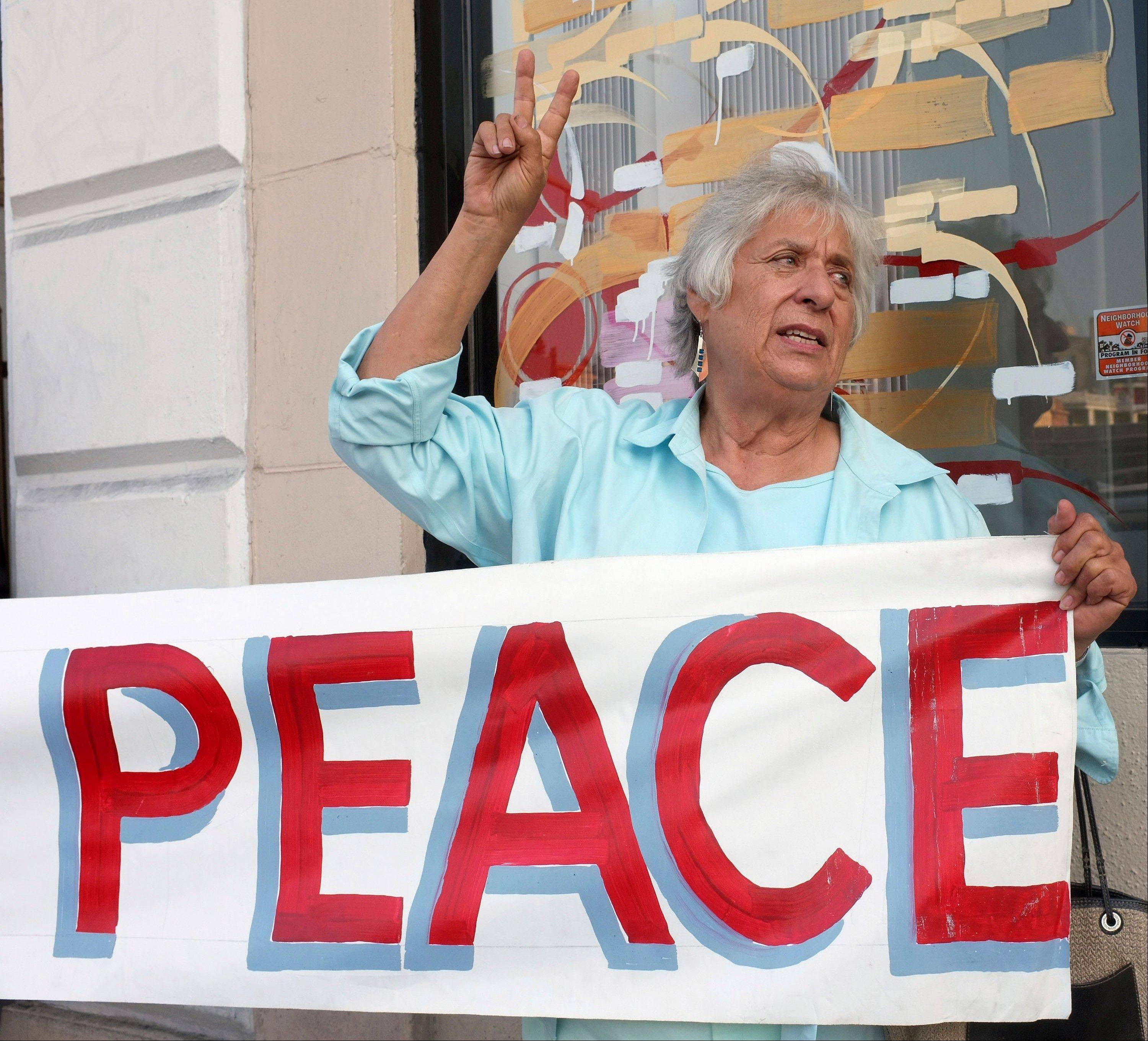 Anti-war activist Joyce Brody rallies for peace outside the offices of Rep. Adam Schiff (D-CA), a senior member of the Intelligence Committee, to urge him to vote against a possible limited military strike on Syria in Hollywood selection of Los Angeles Tuesday, Sept 10, 2013.