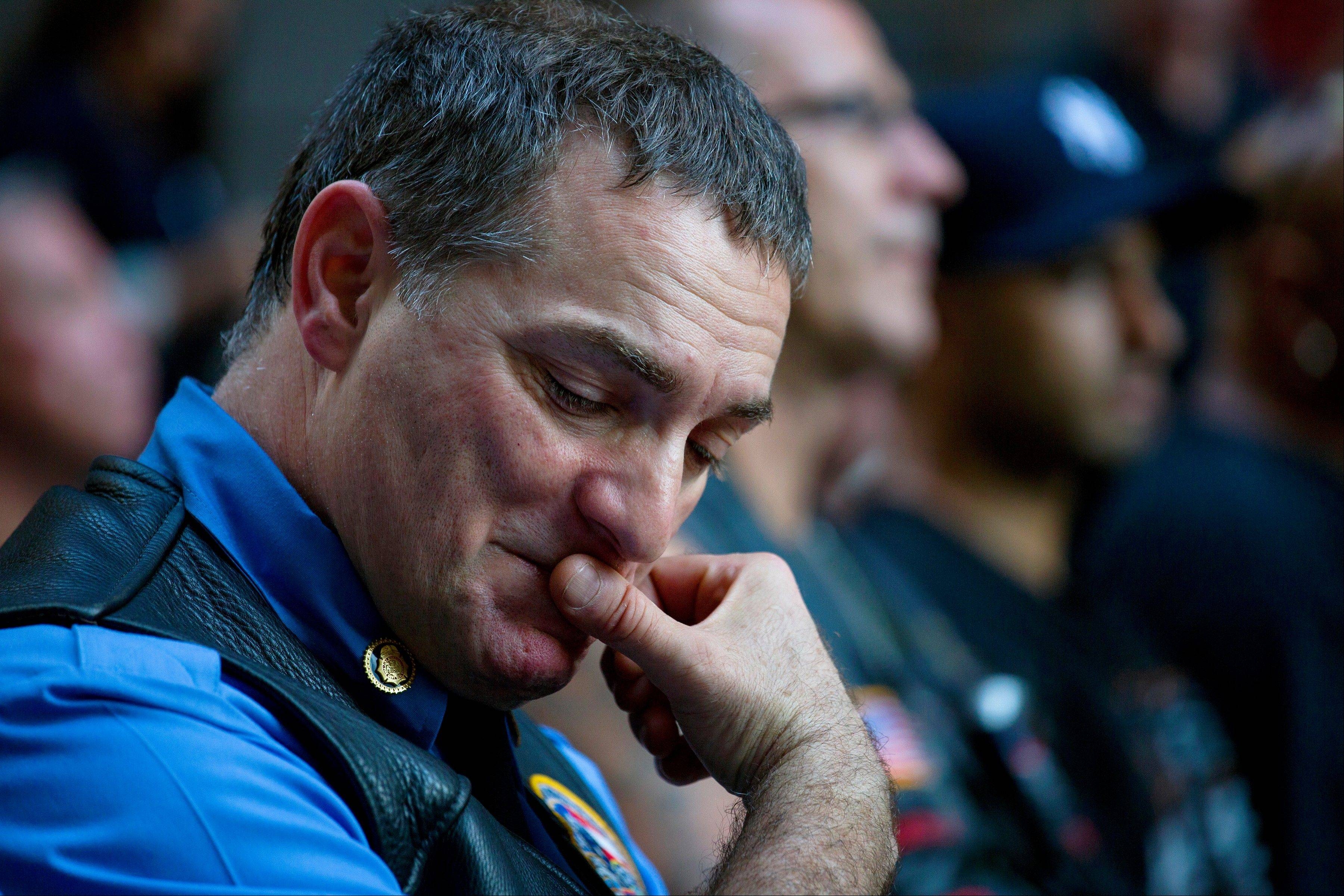 Retired FDNY Marshal, Ernie Medaglia, of Bronxville, N.Y., who was at the attacks at the World Trade Center on Sept. 11, 2001, listens to New York Gov. Andrew Cuomo at a ceremony near the 9/11 Memorial honoring first responders and FDNY Rescue 1 on the 12th anniversary of the attacks on the World Trade Center in New York Wednesday, Sept. 11, 2013.
