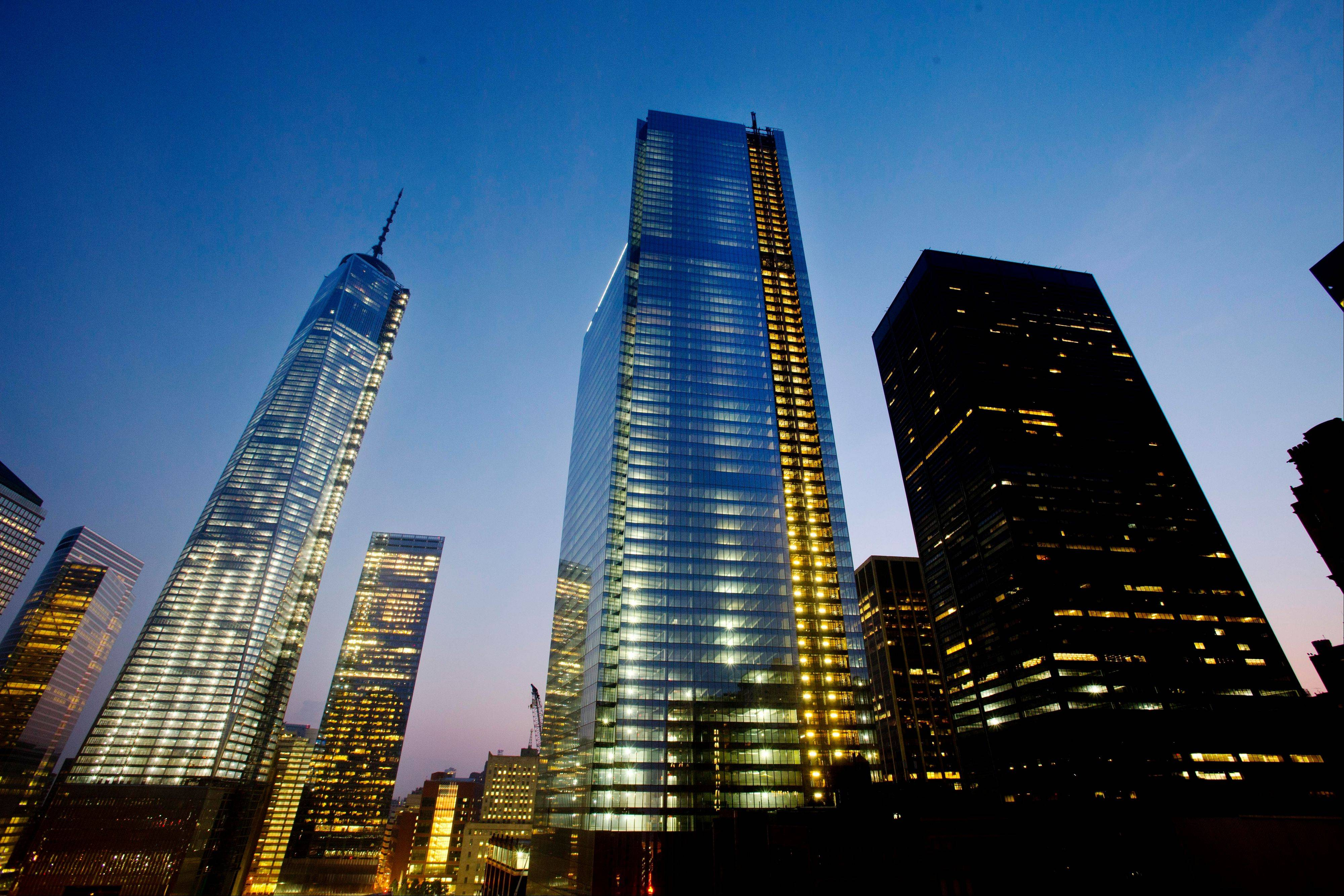 Four World Trade Center, center, stands next to One World Trade Center, left, in lower Manhattan, Wednesday, Sept. 11, 2013 in New York. Ceremonies will be held Wednesday at the memorial to mark the 12th anniversary of the 2001 terrorist attacks.