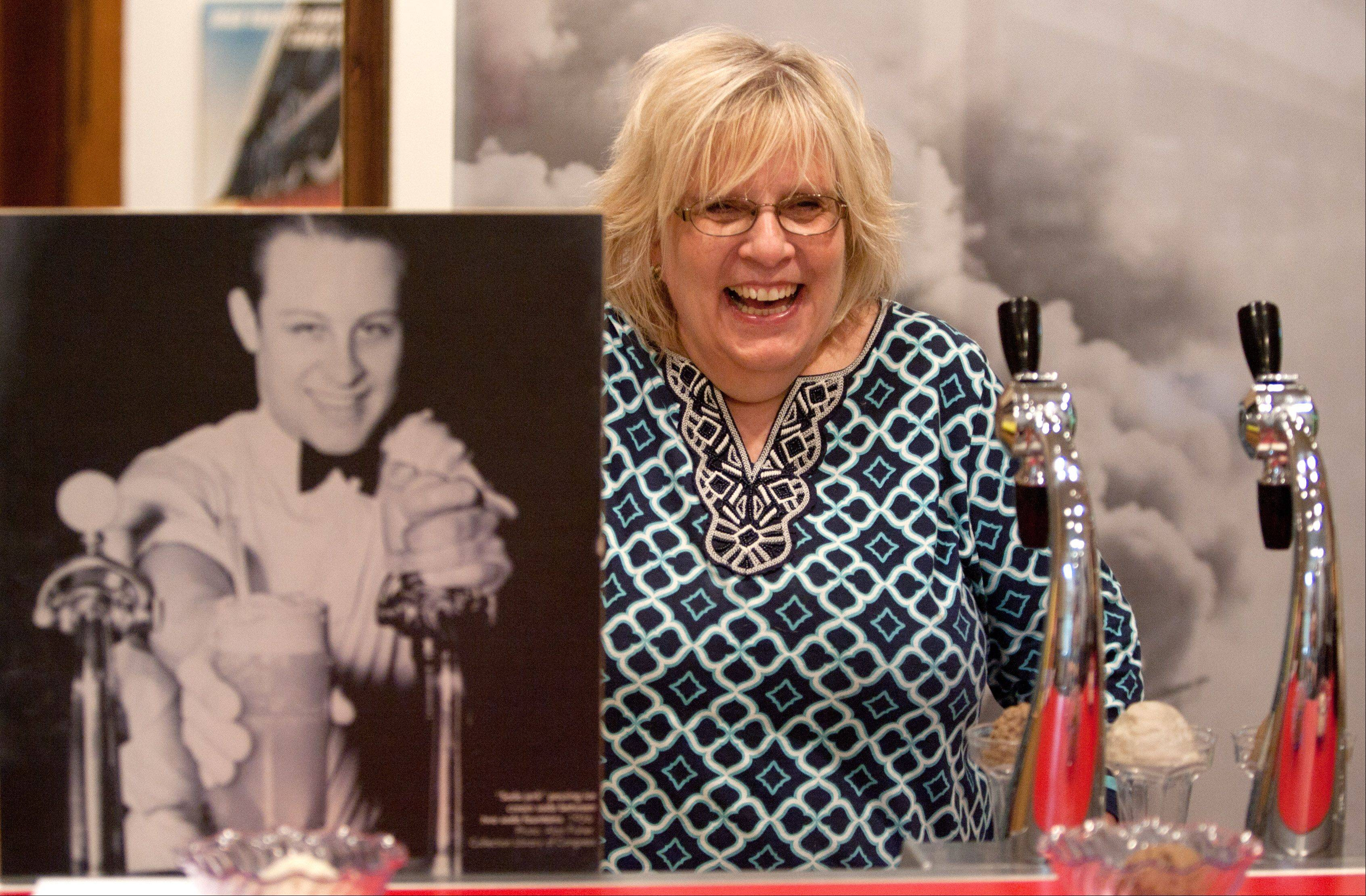Jan Hynes, niece of lifelong Elmhurst resident Jean Schildbach, views the soda fountain that is part of the exhibit.