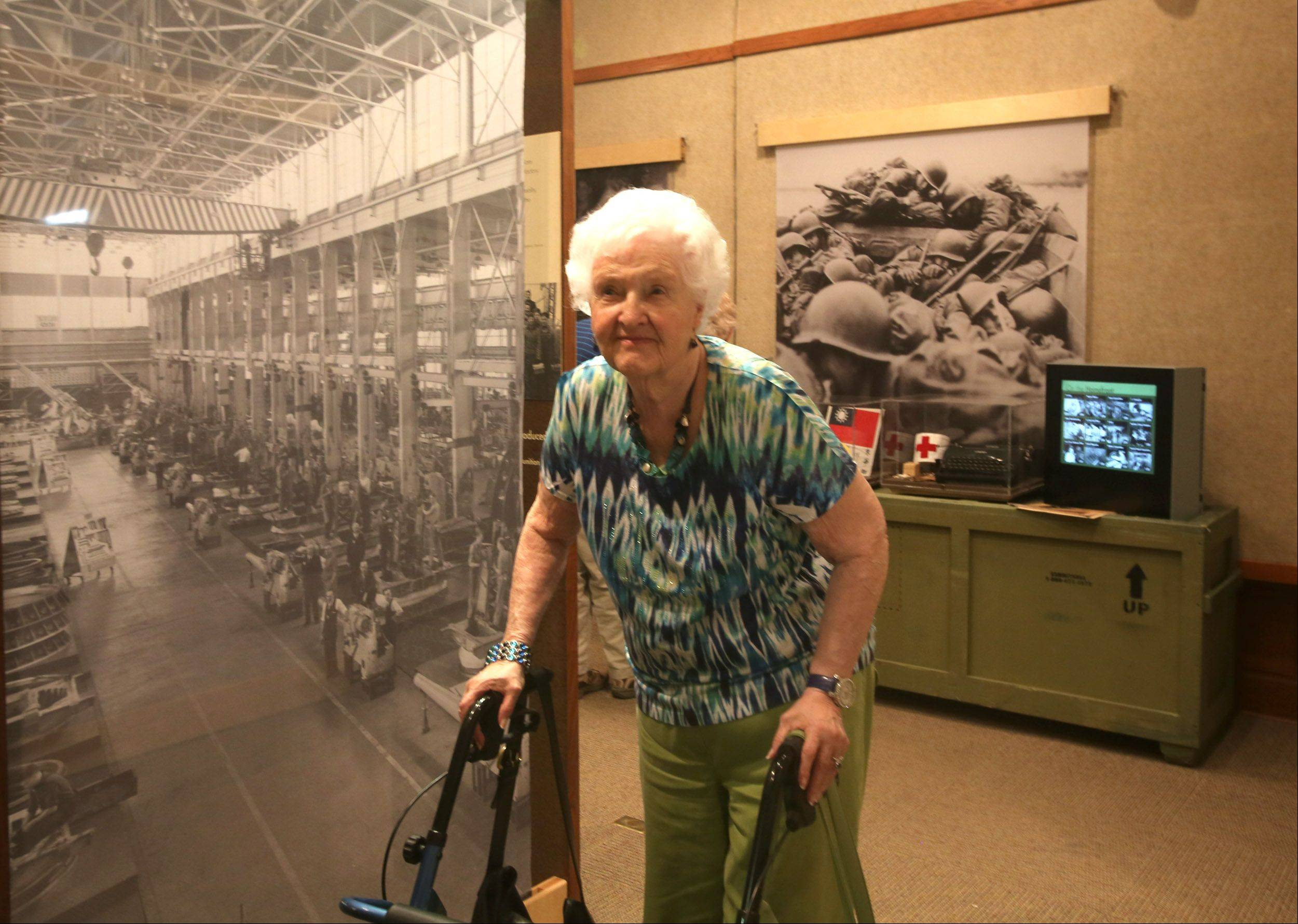 "Jean Schildbach, 93, lifelong Elmhurst resident, visits the ""Our Lives, Our Stories: America's Greatest Generation"" exhibit at the Elmhurst Historical Museum."