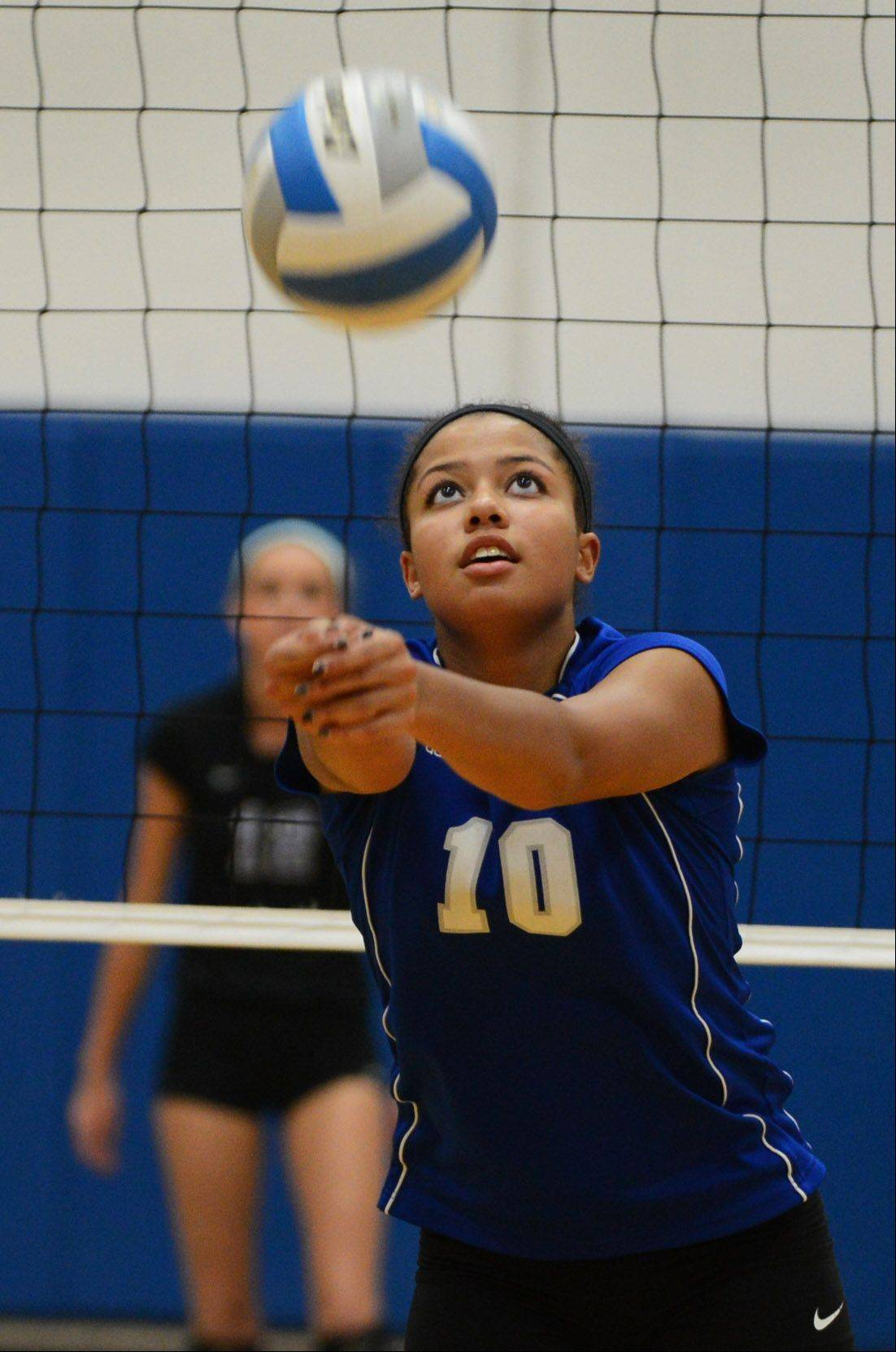 Vernon Hills' Tori Smith sets the ball during Wednesday night's volleyball match against visiting Lakes High School.