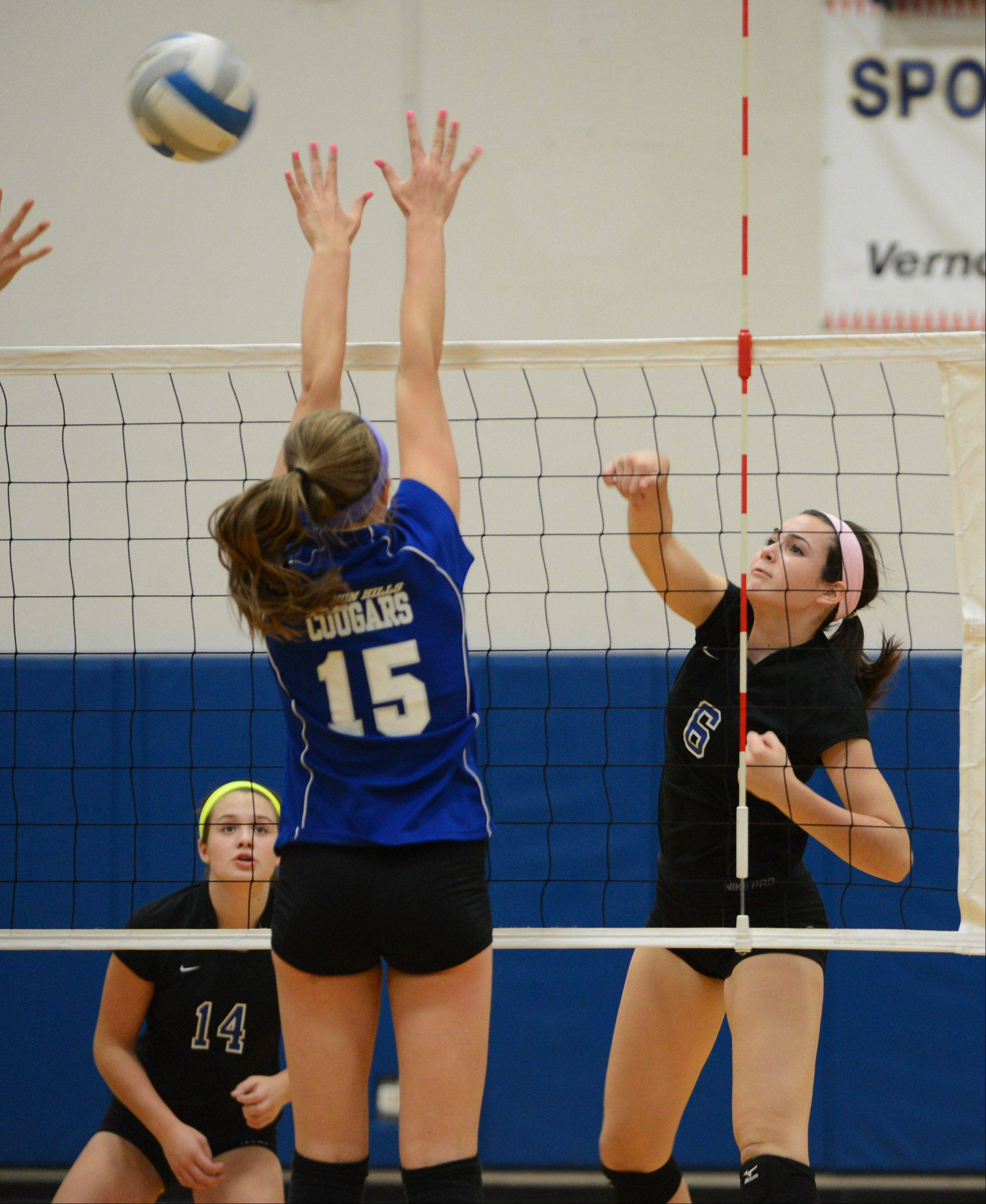 Lakes' McKenna Lahr (6) knocks the ball past Vernon Hills' Katie Brettmann during Wednesday's volleyball game in Vernon Hills.