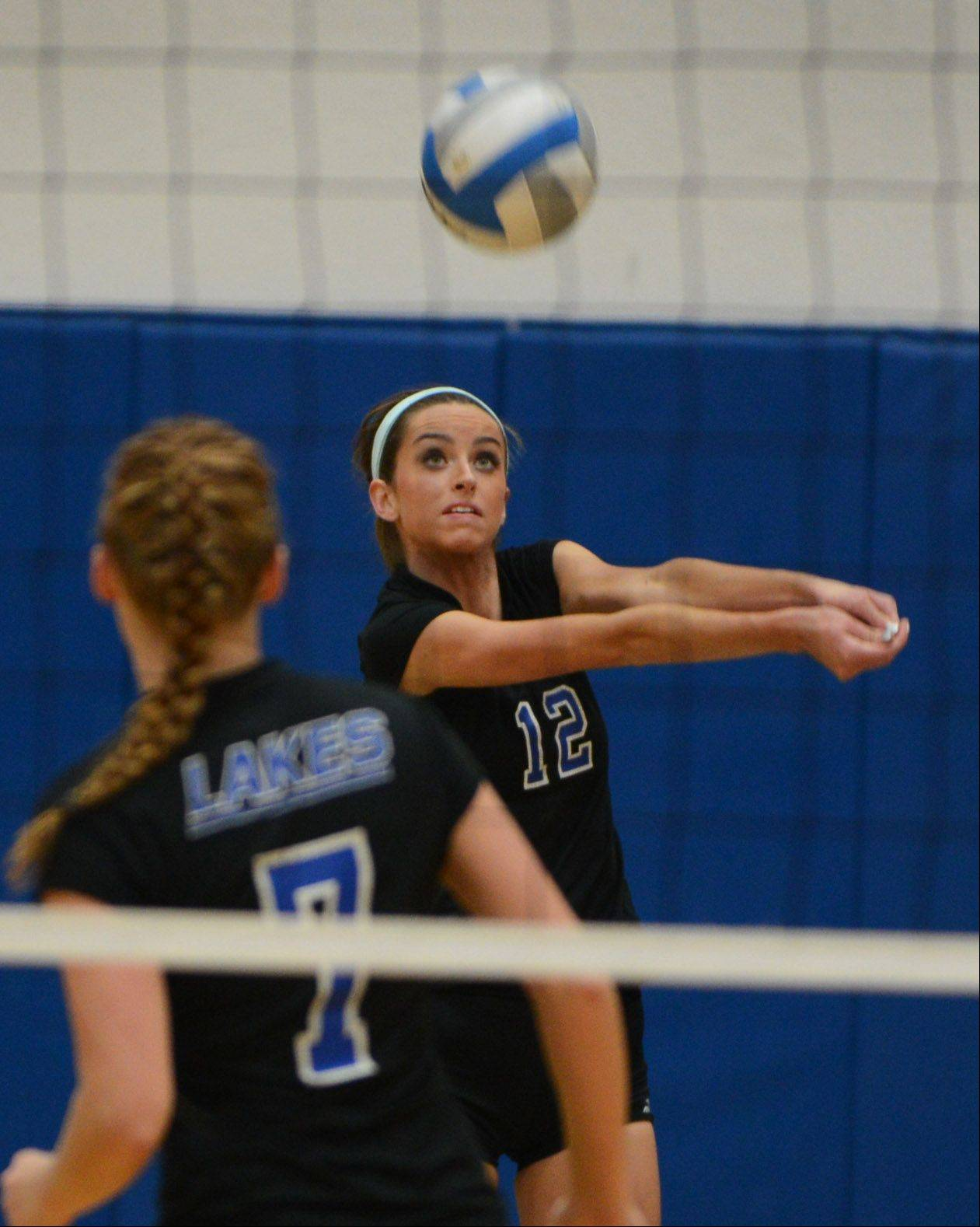 Lakes' Haley Halberg plays the ball during Wednesday night's volleyball game in Vernon Hills.