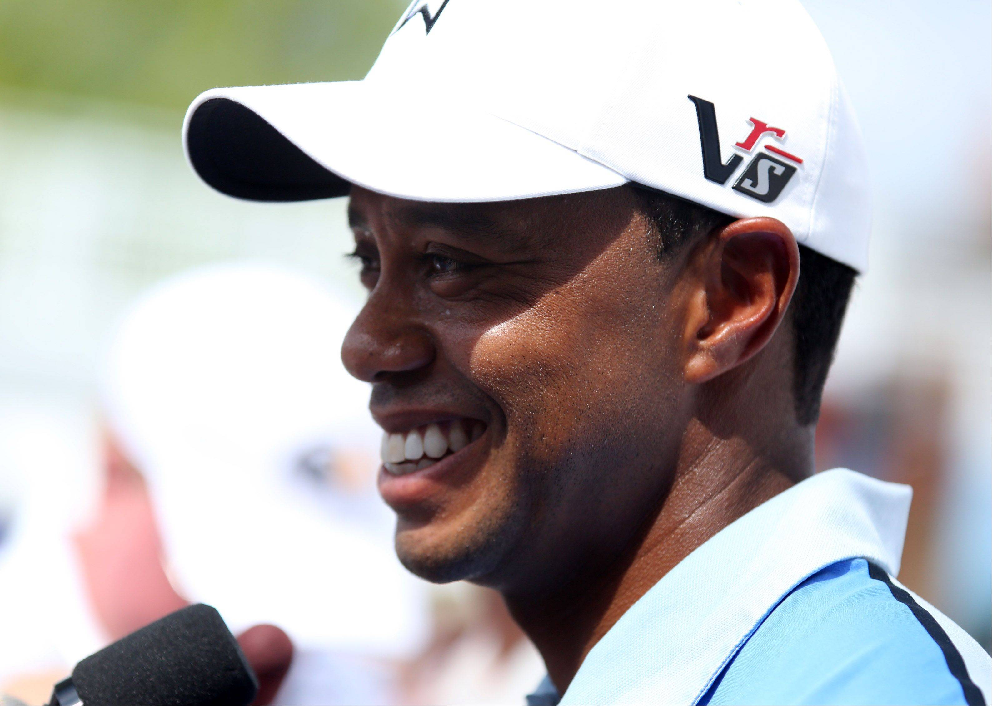 Tiger Woods talks about the course during a press conference.