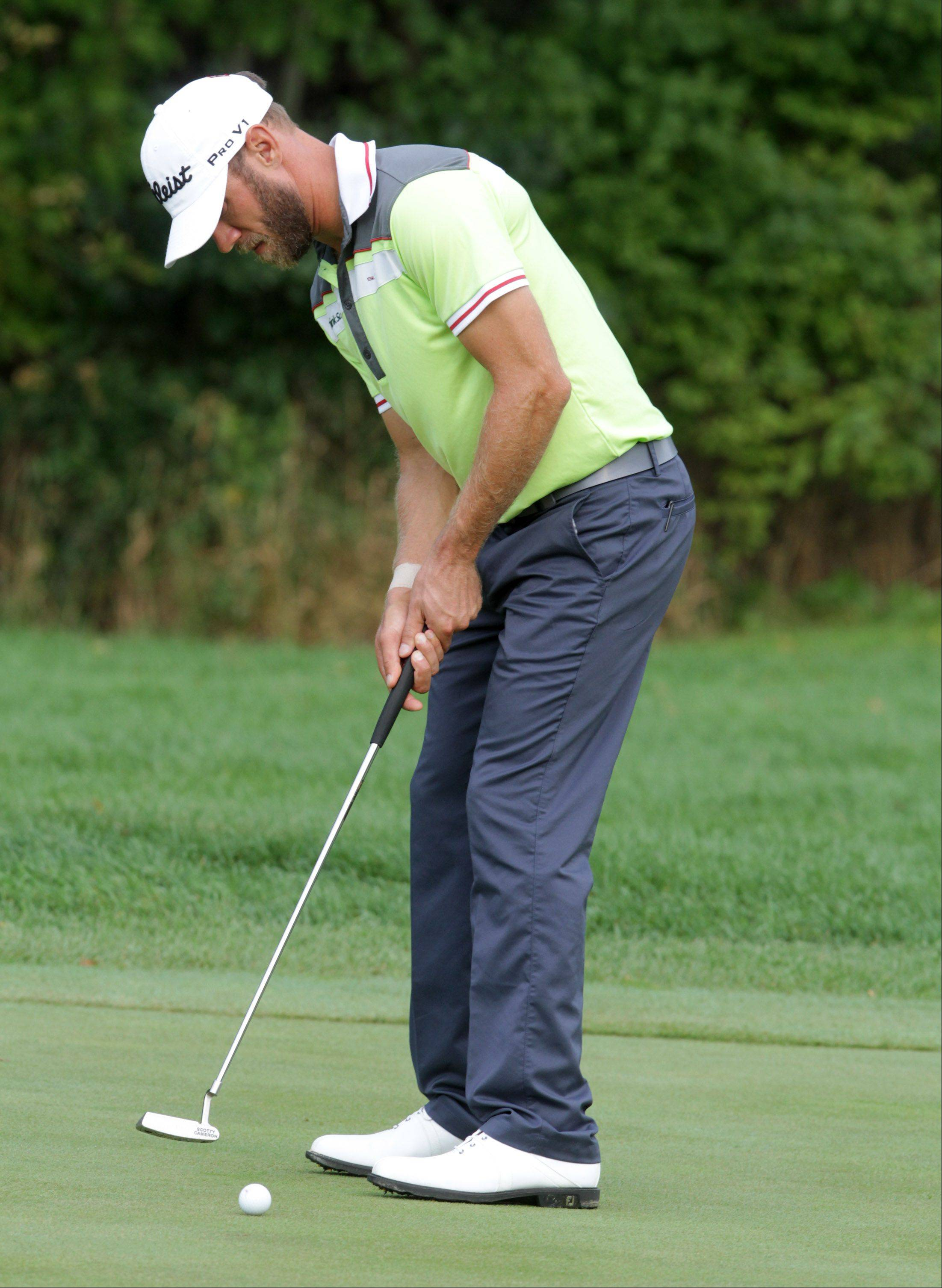 Gram DeLaet putts on the sixth green.