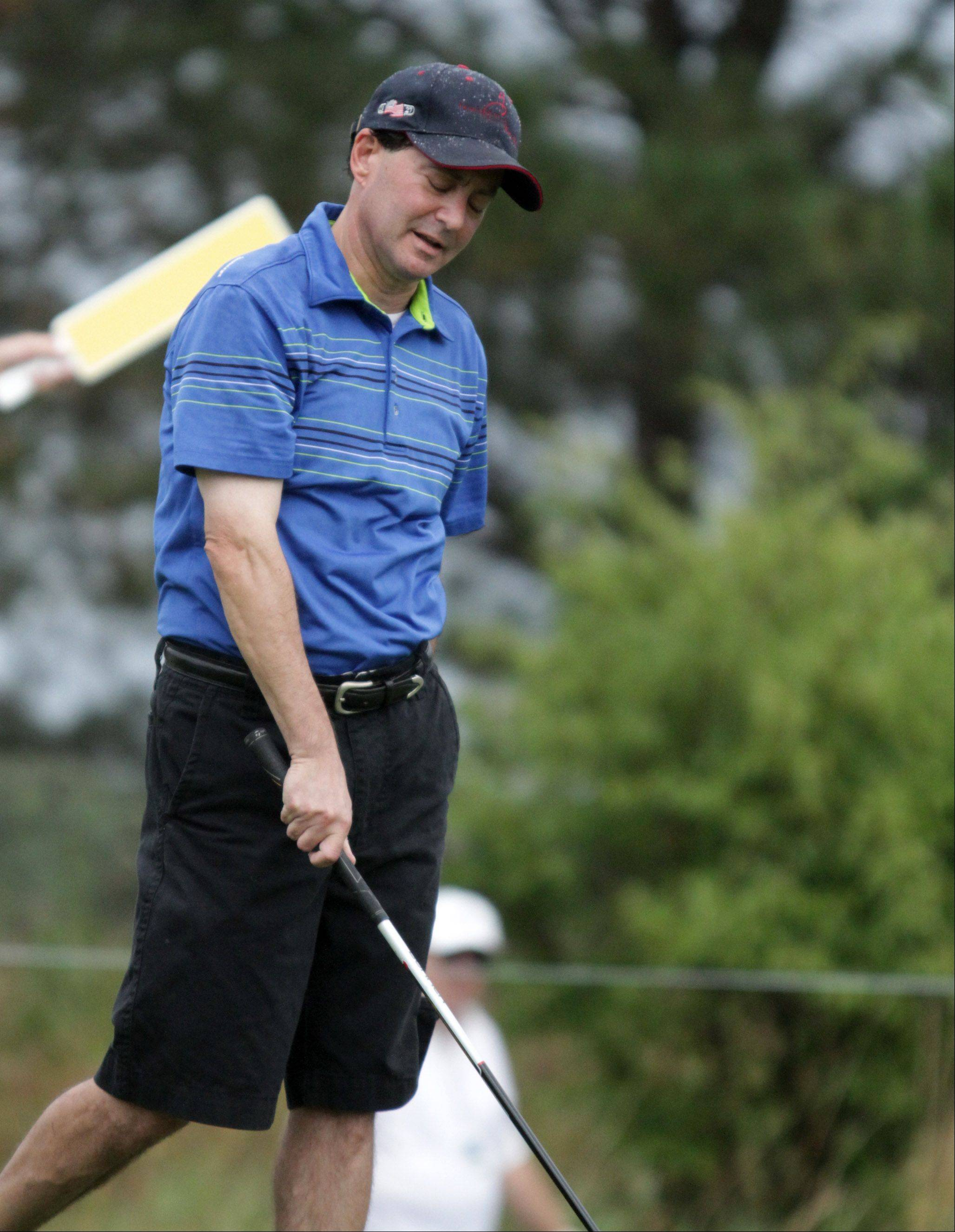 Daily Herald sports columnist Barry Rozner reacts to his tee swing on the tenth hole.