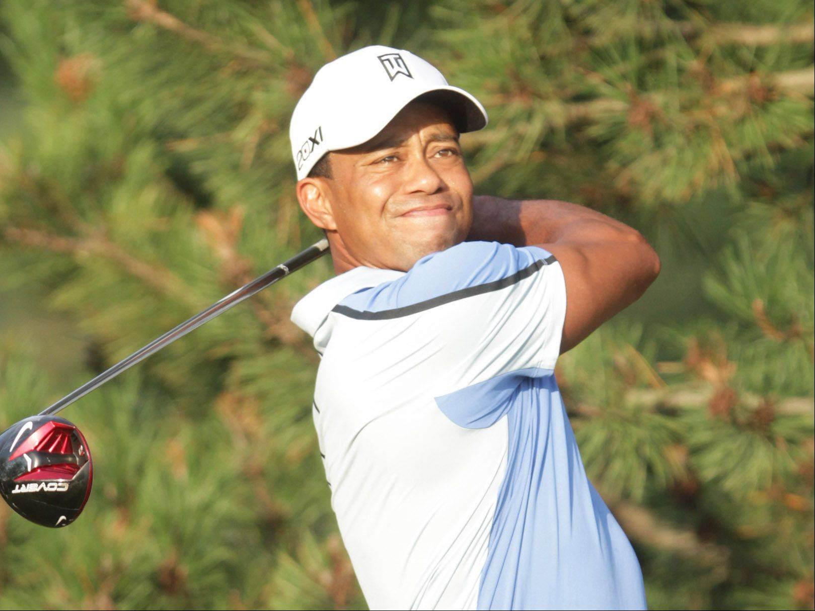 Tiger Woods tees off on the third hole.