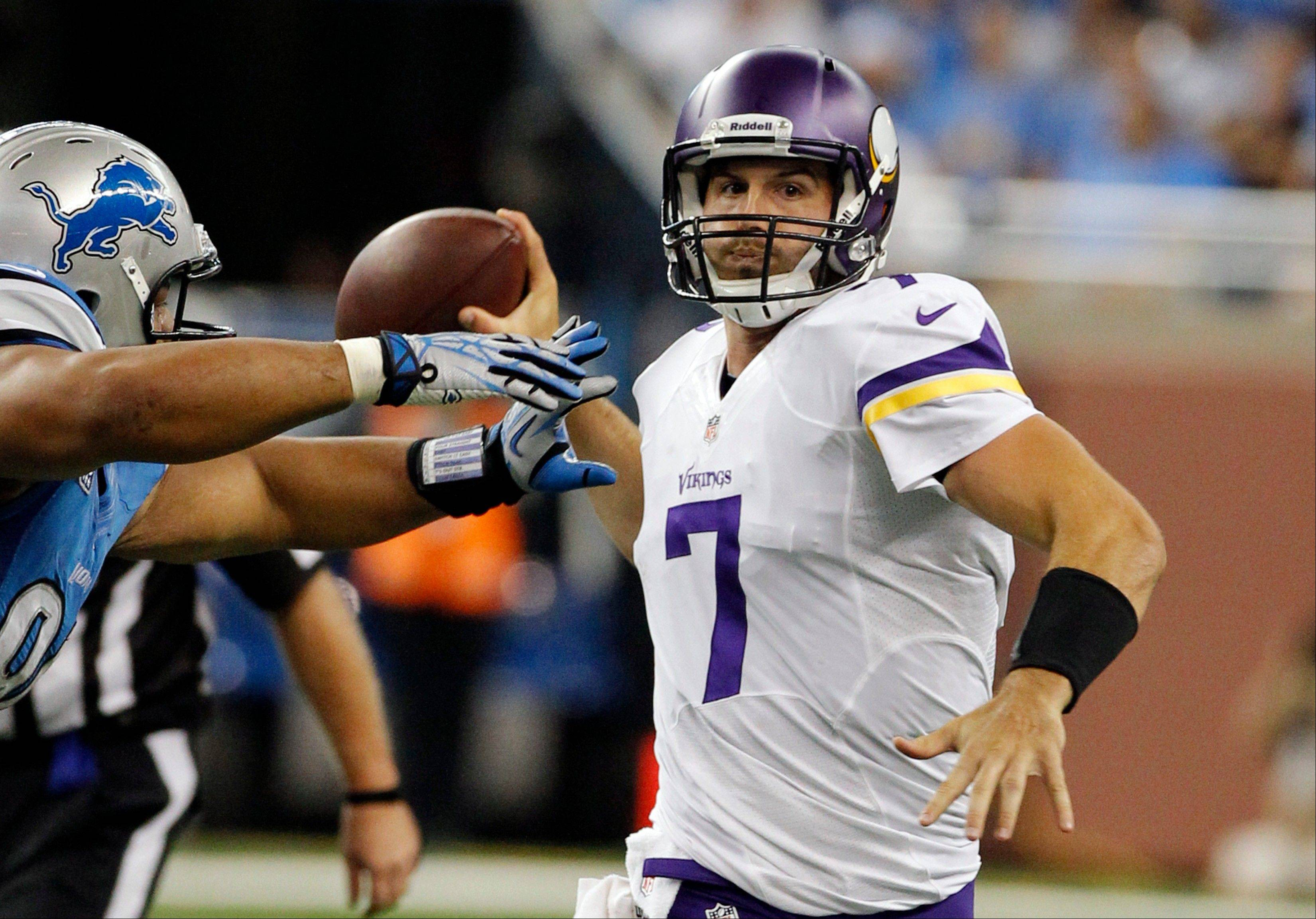 Minnesota Vikings quarterback Christian Ponder (7) is pressured by Detroit Lions defensive tackle Ndamukong Suh Sunday during the third quarter at Ford Field in Detroit.