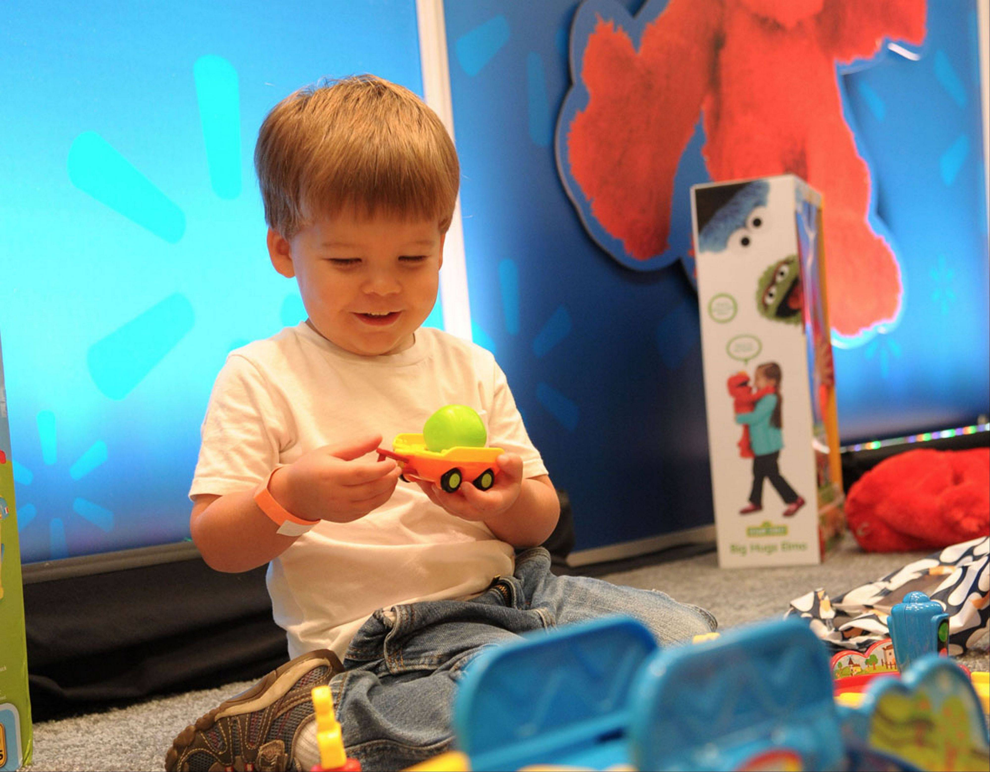 One of about 1,000 boys and girls aged 18 months to 10 years plays with a toy as part of an event during in August. The children chose their favorites, resulting in a top 20 list of kid-approved toys.