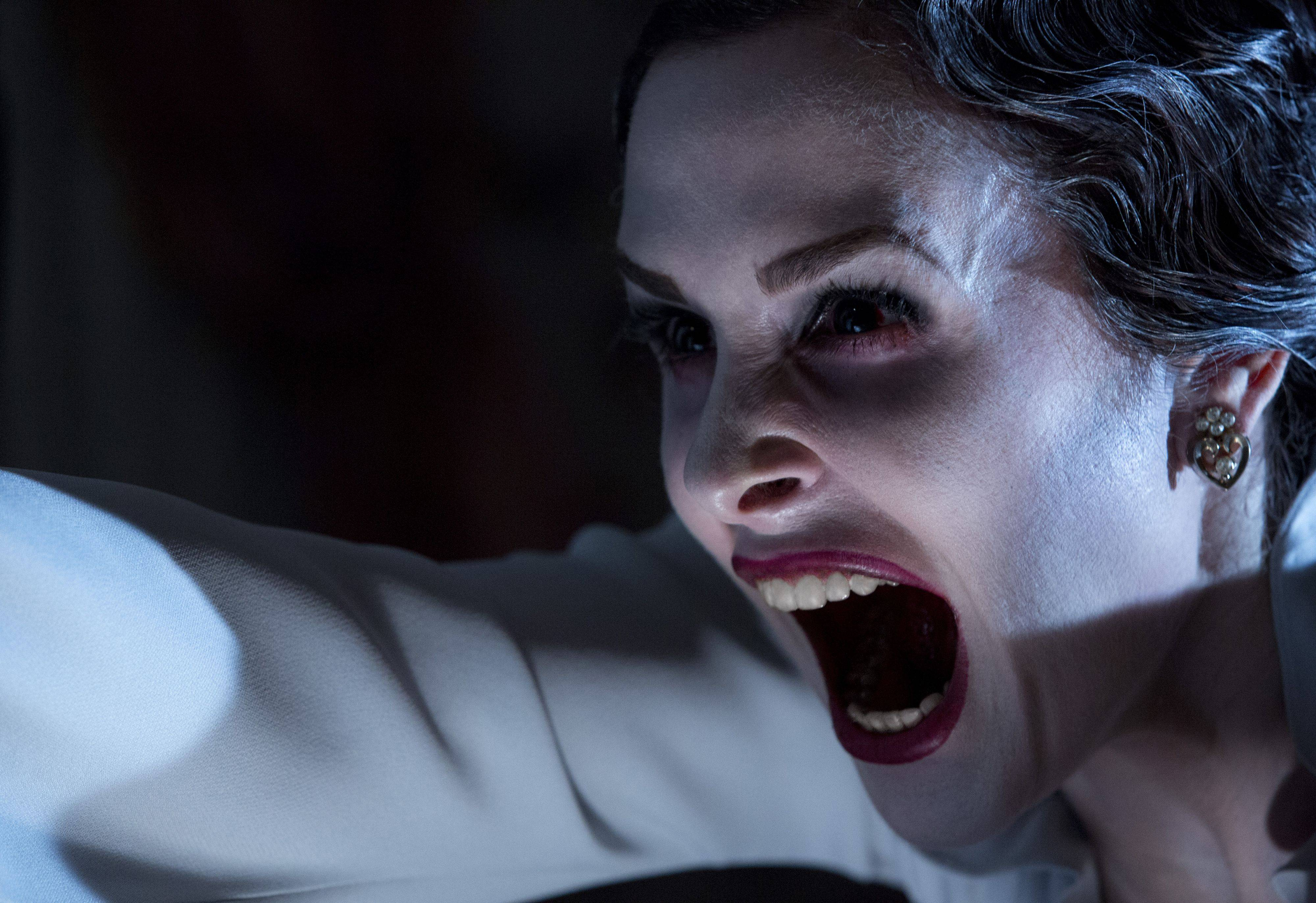 "The malevolent ghost of a scary mother (Danielle Bisutti) doesn't like living people messing with her plans of mass murder in the sequel ""Insidious Chapter 2."""