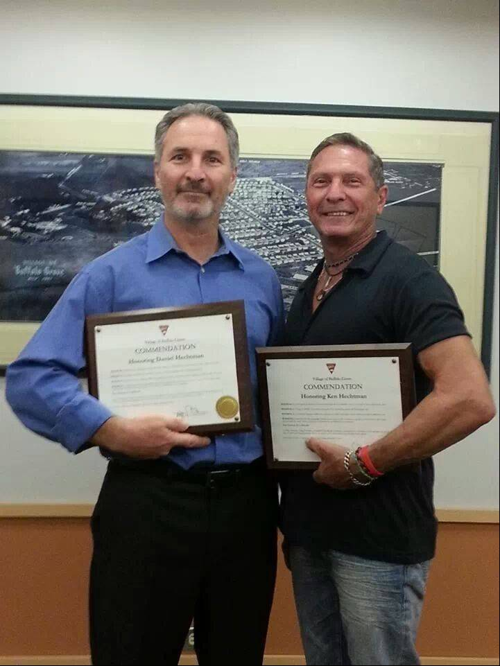 Daniel and Ken Hechtman, Buffalo Grove residents and owners of a kosher restaurant in Skokie, helped save people injured in a fiery crash last April on the Tri-State Tollway. They were honored this week by the Buffalo Grove village board.