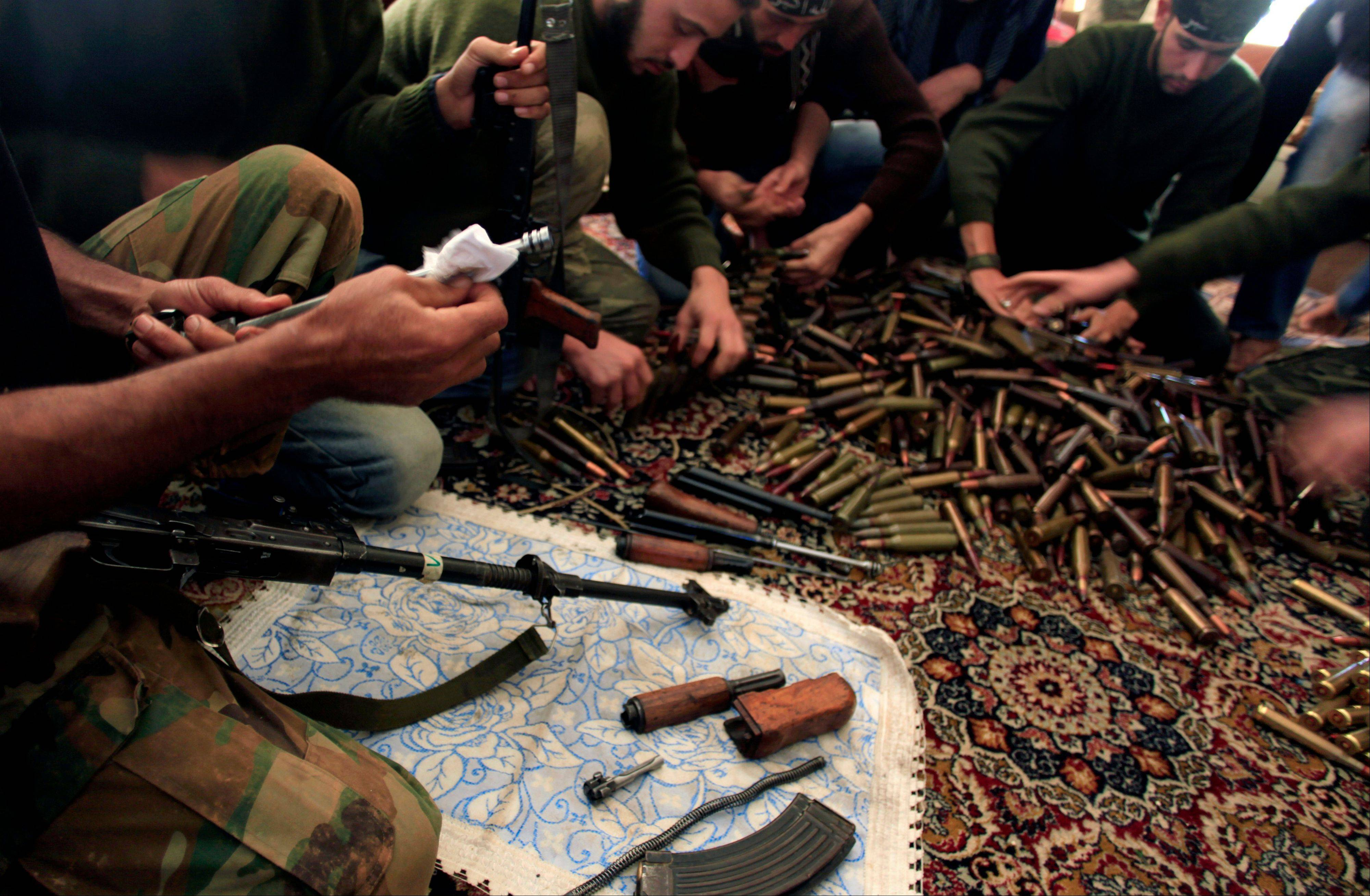 Free Syrian Army fighters clean their weapons and check ammunition at their base on the outskirts of Aleppo, Syria. The crisis over chemical weapons in Syria has underlined a central dilemma for the West as it tries to deal with the country's civil war: the lack of attractive alternatives to President Bashar Assad.