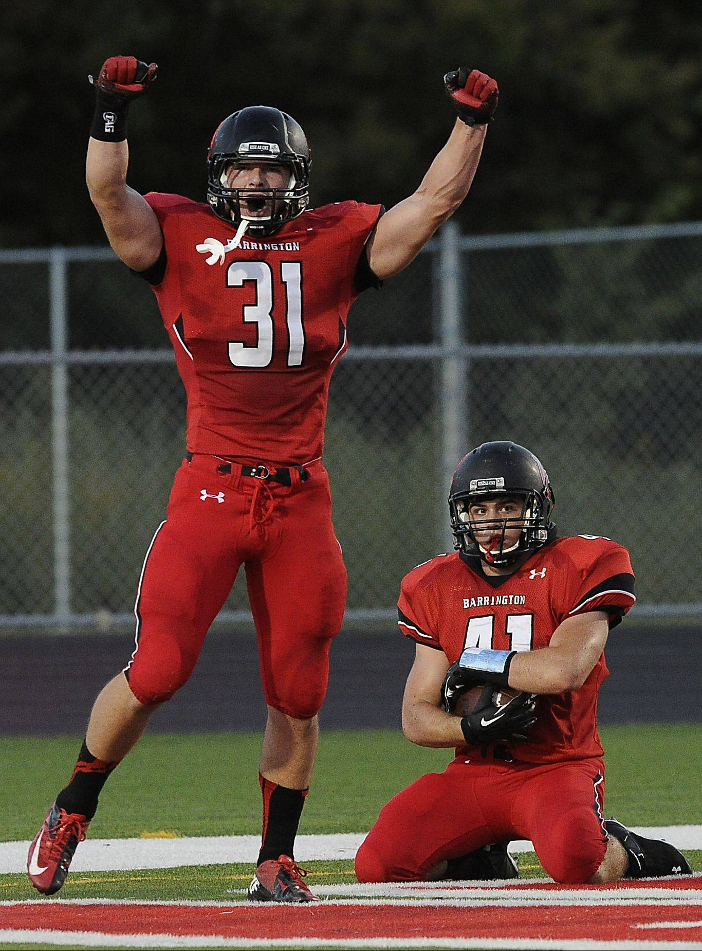 Barrington�s Mark Bornhofen recovers a blocked punt for a touchdown as teammate Colin Castagna celebrates during Thursday�s matchup against visiting Rolling Meadows.