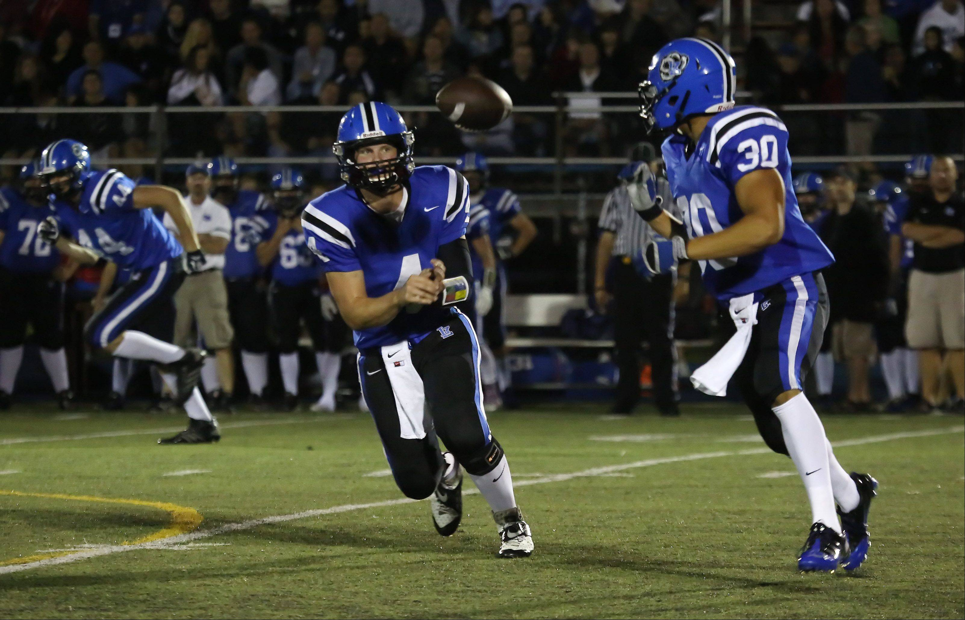 Lake Zurich quarterback Noah Allgood pitches out to running back Ben Klett.