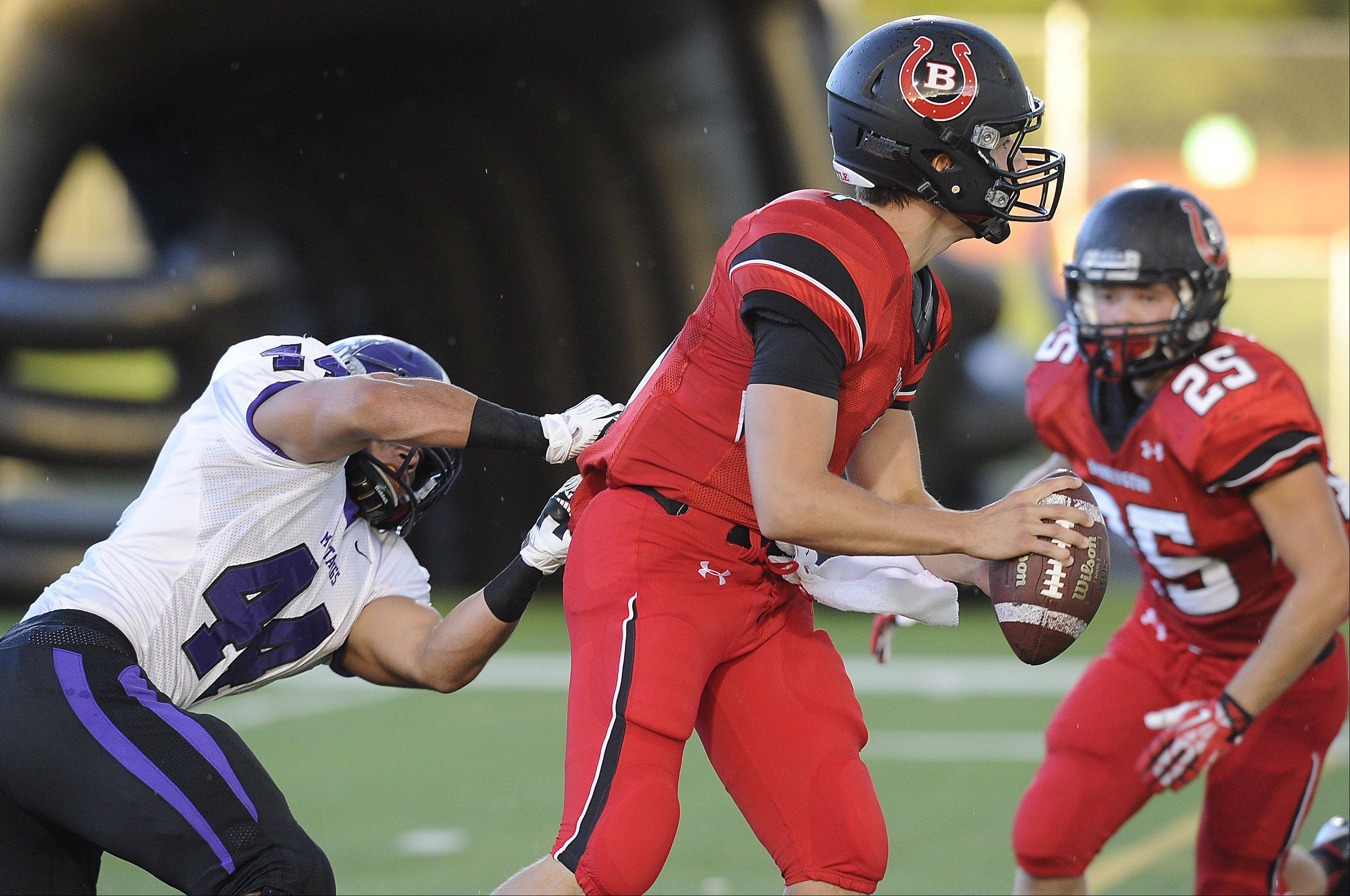 Rolling Meadows' Eddie Cardenas sacks Barrington quarterback Daniel Kubiuk in the first quarter.