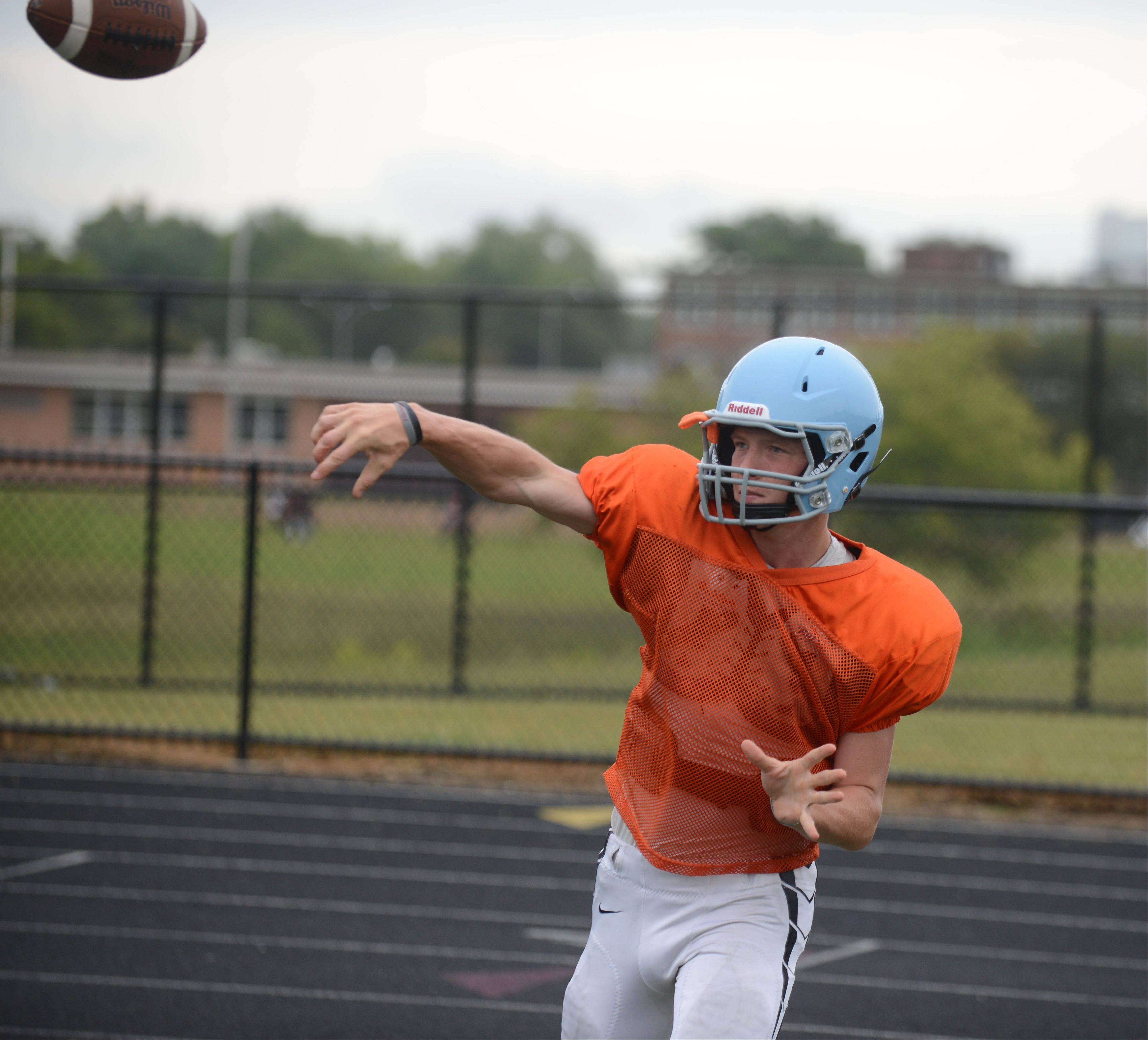 Paul Michna/pmichna@dailyherald.com ¬ Quater Back Brian Johnson took part in Thursdays practice at Willowbrook High School.