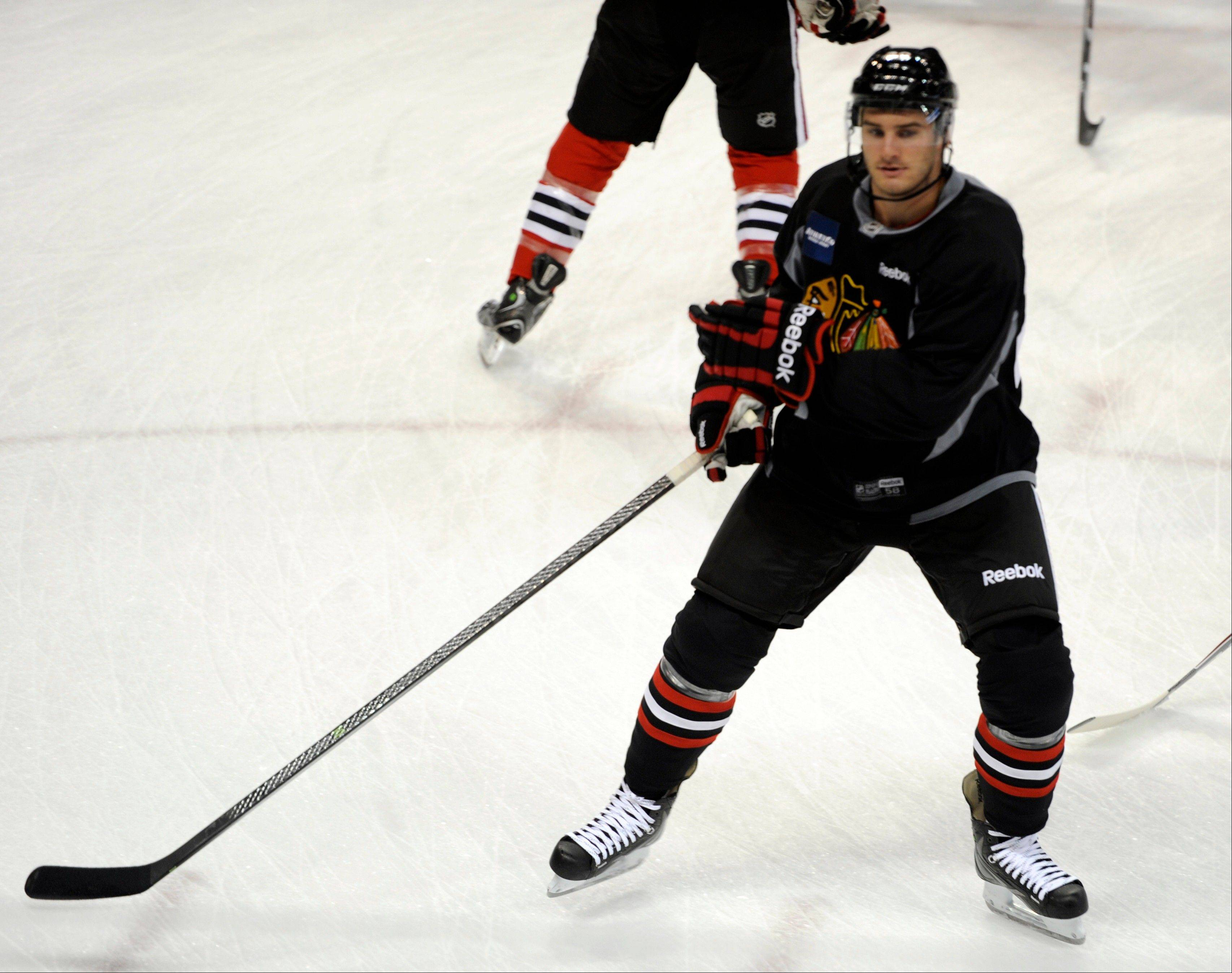 Chicago Blackhawks' Brandon Saad takes part in a drill at training camp on the campus of the University of Notre Dame in South Bend, Ind., Thursday. Saad is getting a tryout at center this season.