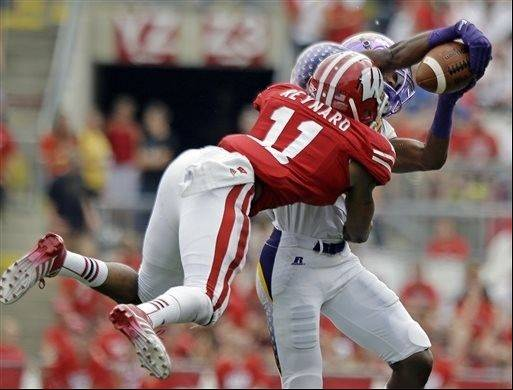 Tennessee Tech�s Jordan Smith catches a pass in front of Wisconsin�s T.J. Reynard during the second half last Saturday in Madison, Wis. The 20th-ranked Badgers face a quick-strike Arizona State offense led by quarterback Taylor Kelly this Saturday on the road.