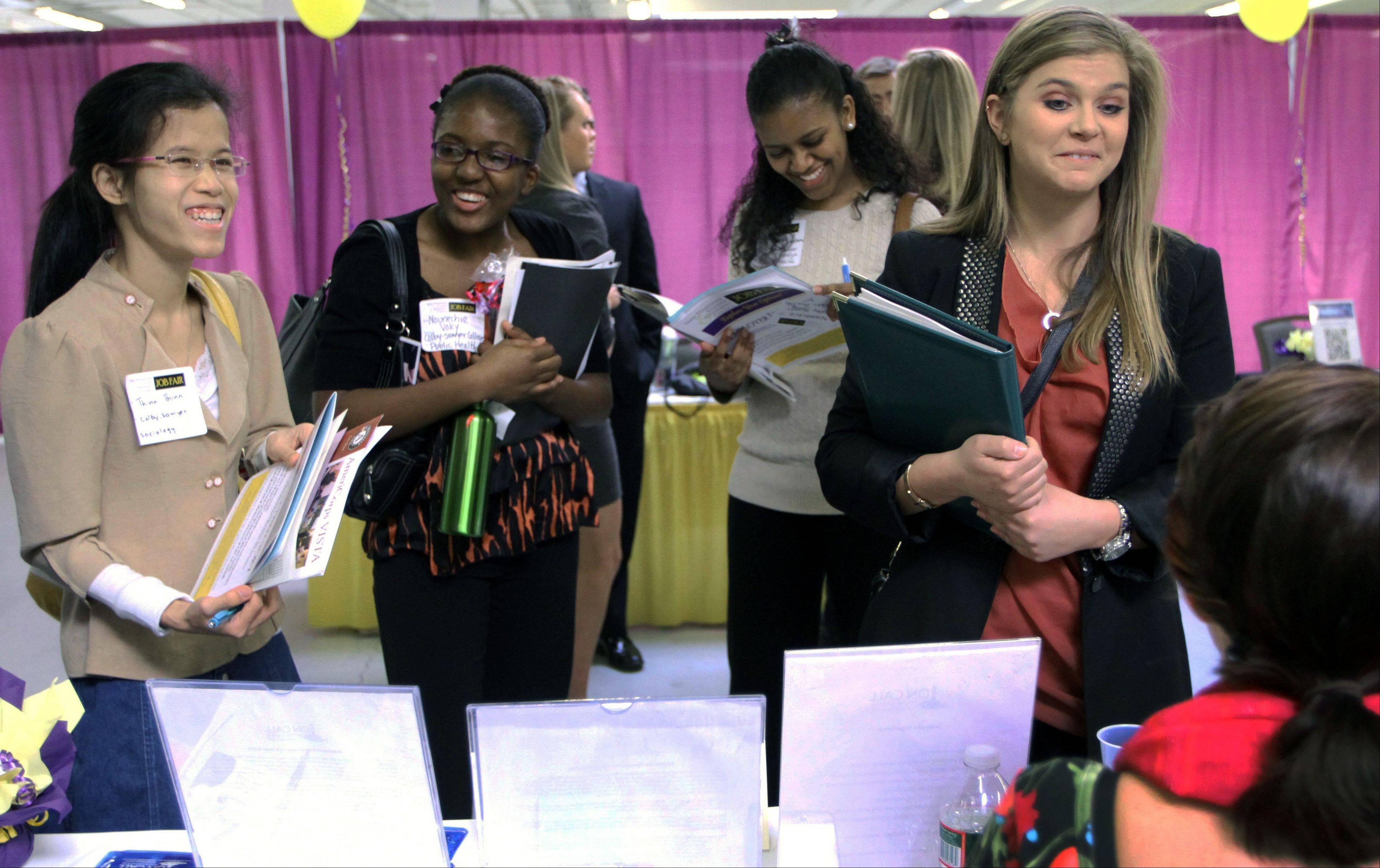 Women attend a job fair for college students in Manchester, N.H., in April 2012. A report released Thursday shows U.S. women have recovered all the jobs they lost during the Great Recession.
