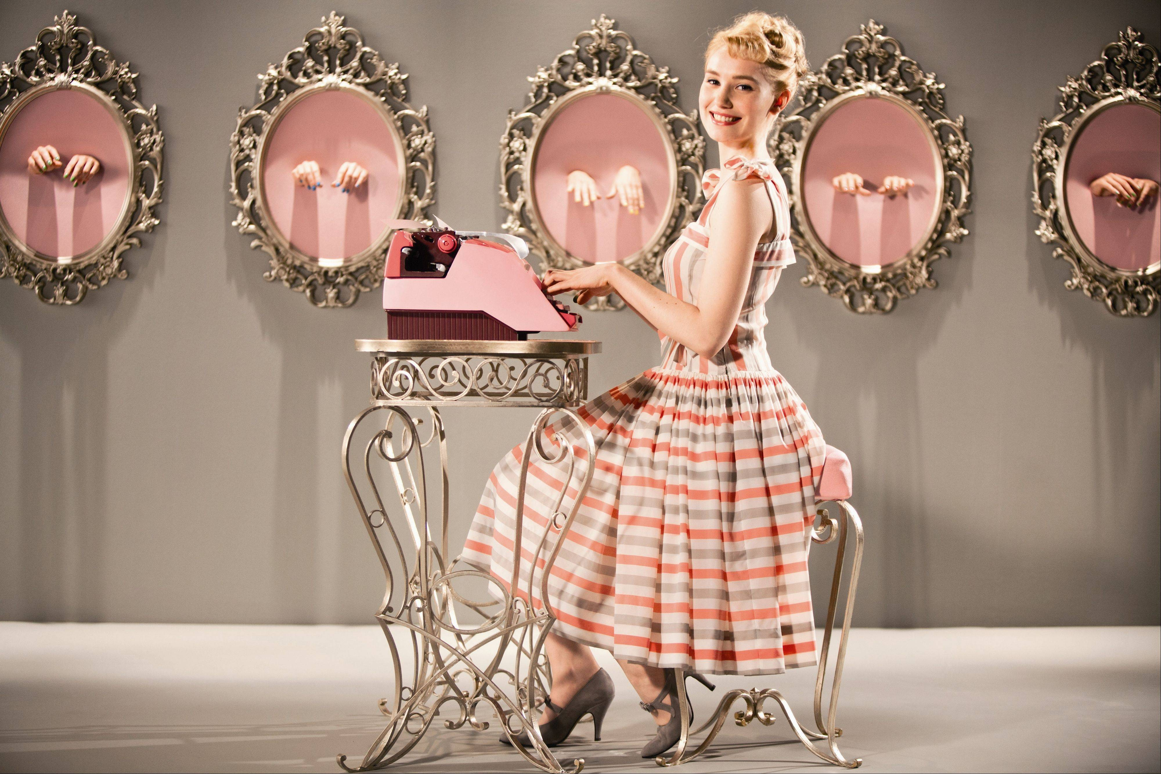 "Rose (Deborah Francois) prepares for the world typing championship in the French comedy ""Populaire."""