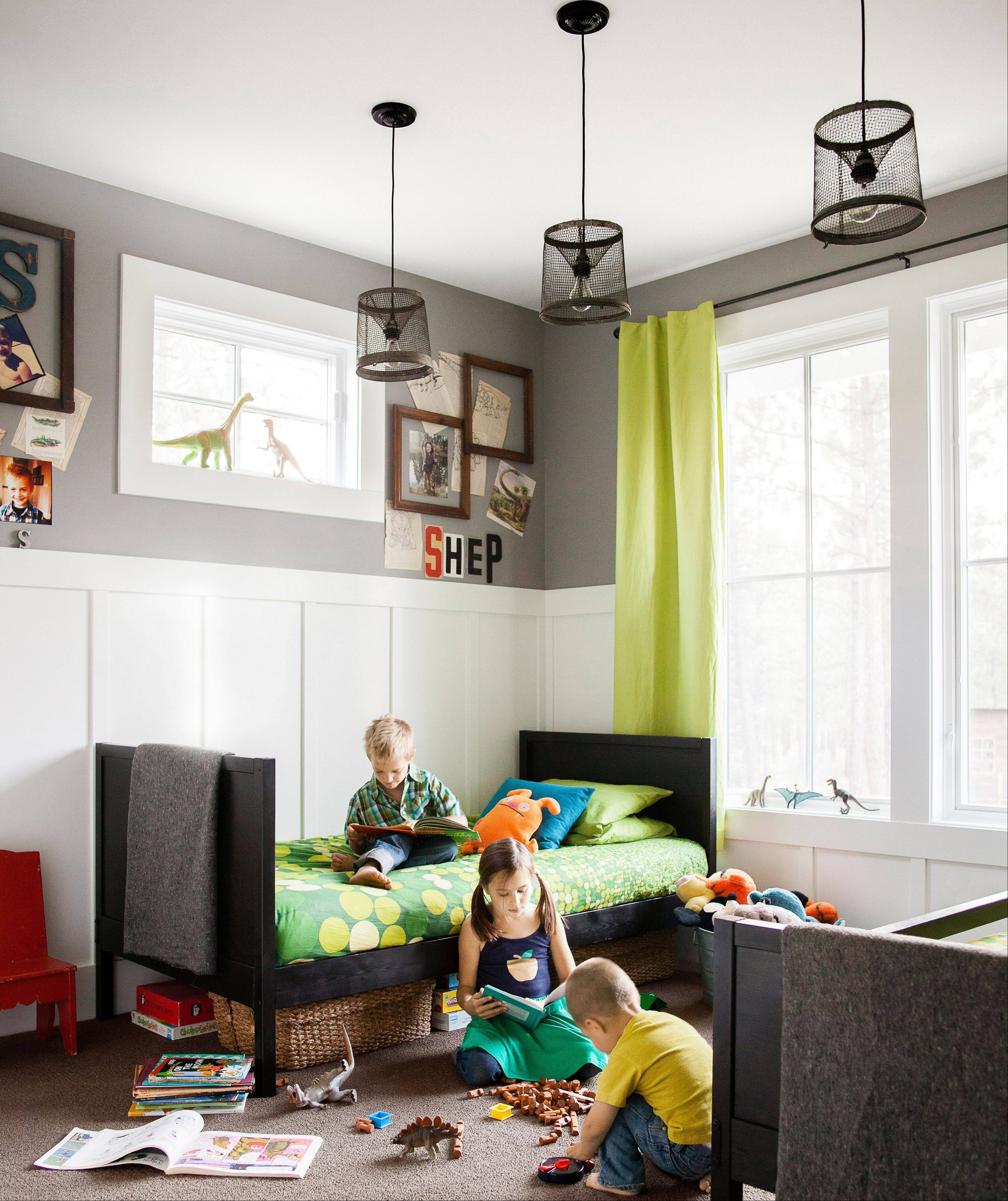 A boys' room featured in Country Living magazine that is shared by a 5-year-old and a 2-year-old features bright-green window panels that amp up the energy in the room without feeling too childish.