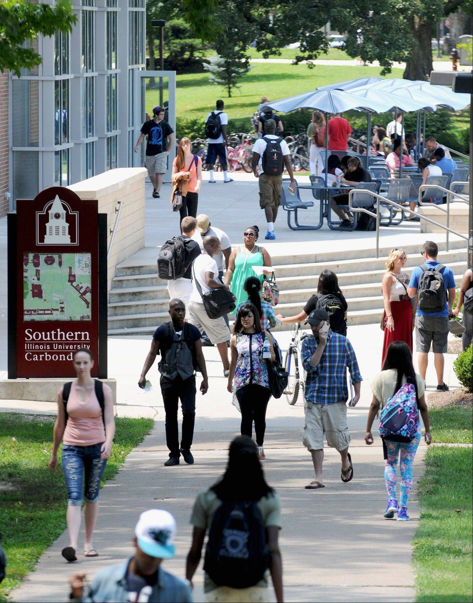 Students walk between Morris Library and Faner Hall last month on the campus of Southern Illinois University in Carbondale. SIU drew its largest freshman class in two decades after offering new scholarships and financial aid.