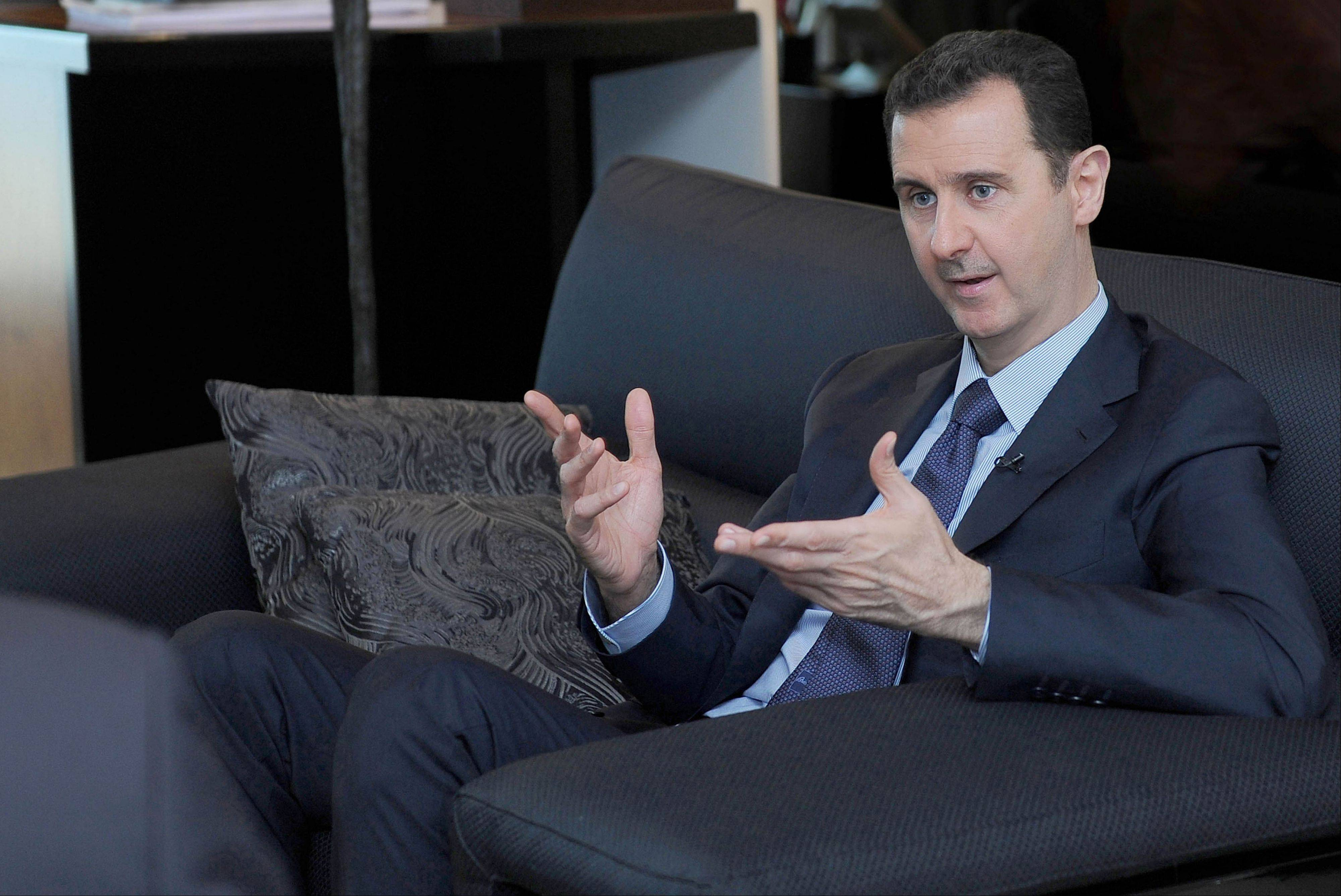 Syrian President Bashar Assad says his government has agreed to surrender its chemical weapons in response to Russia's initiative and not because of the U.S. threat of attack.