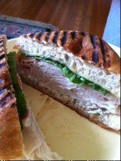 "This is the ""Santa's Village"" sandwich at In the Neighborhood Meet Market, a deli that just opened in East Dundee. The eatery has named all of its sandwiches after institutions, longtime families and pillars of the community in the Dundees and Carpentersville. This turkey sandwich features a dill pickle, havarti cheese, lettuce, tomato and dill mayo all on wheat ciabatta bread."