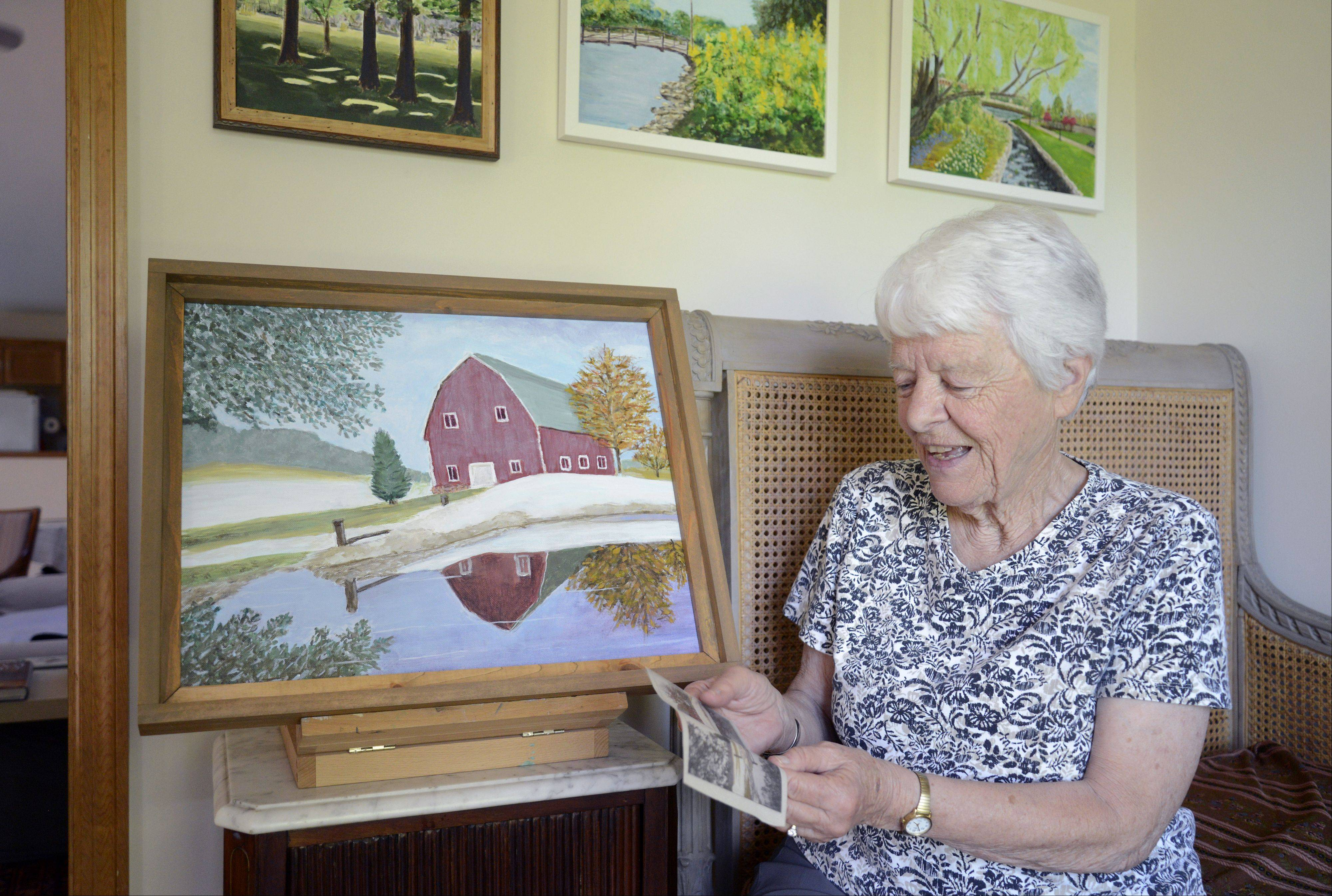Laura Stoecker/lstoecker@dailyherald.com Janine Webbles of Batavia painted the barn at LeRoy Oakes Forest Preserve in St. Charles using a photograph by Daily Herald staff photographer, Laura Stoecker, as a guide. The original photo was taken on Feb. 17, 2011 -- after a big blizzard -- and was painted in the same year by Webbles. She is an avid lover of nature, especially wildflowers, and paintings of local forest preserves and the Batavia Riverwalk hang on her wall.