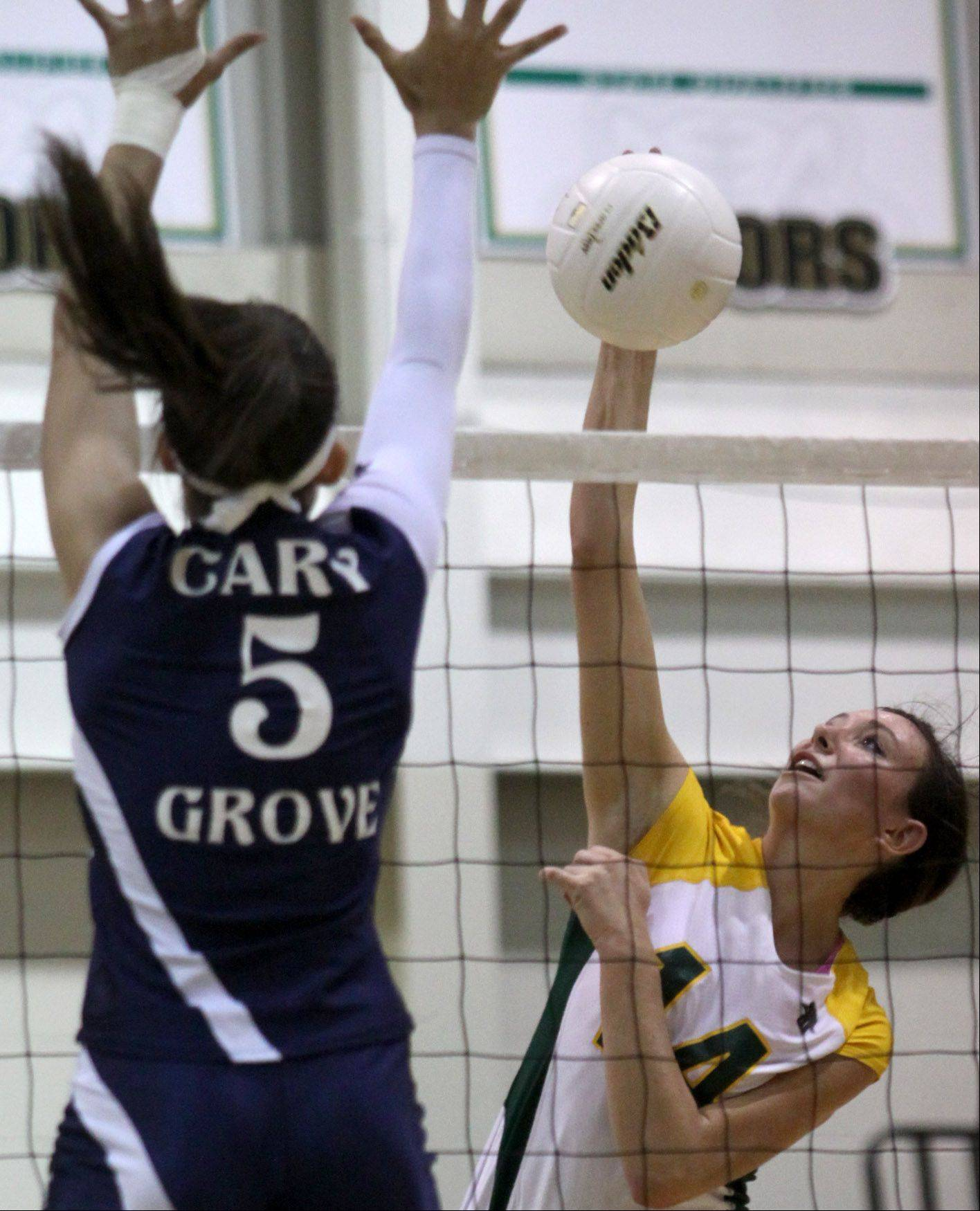 Cary-Grove's Kayli Trausch, left, tries to block Crystal Lake South's Avalon Nero, right, Thursday night in Crystal Lake.