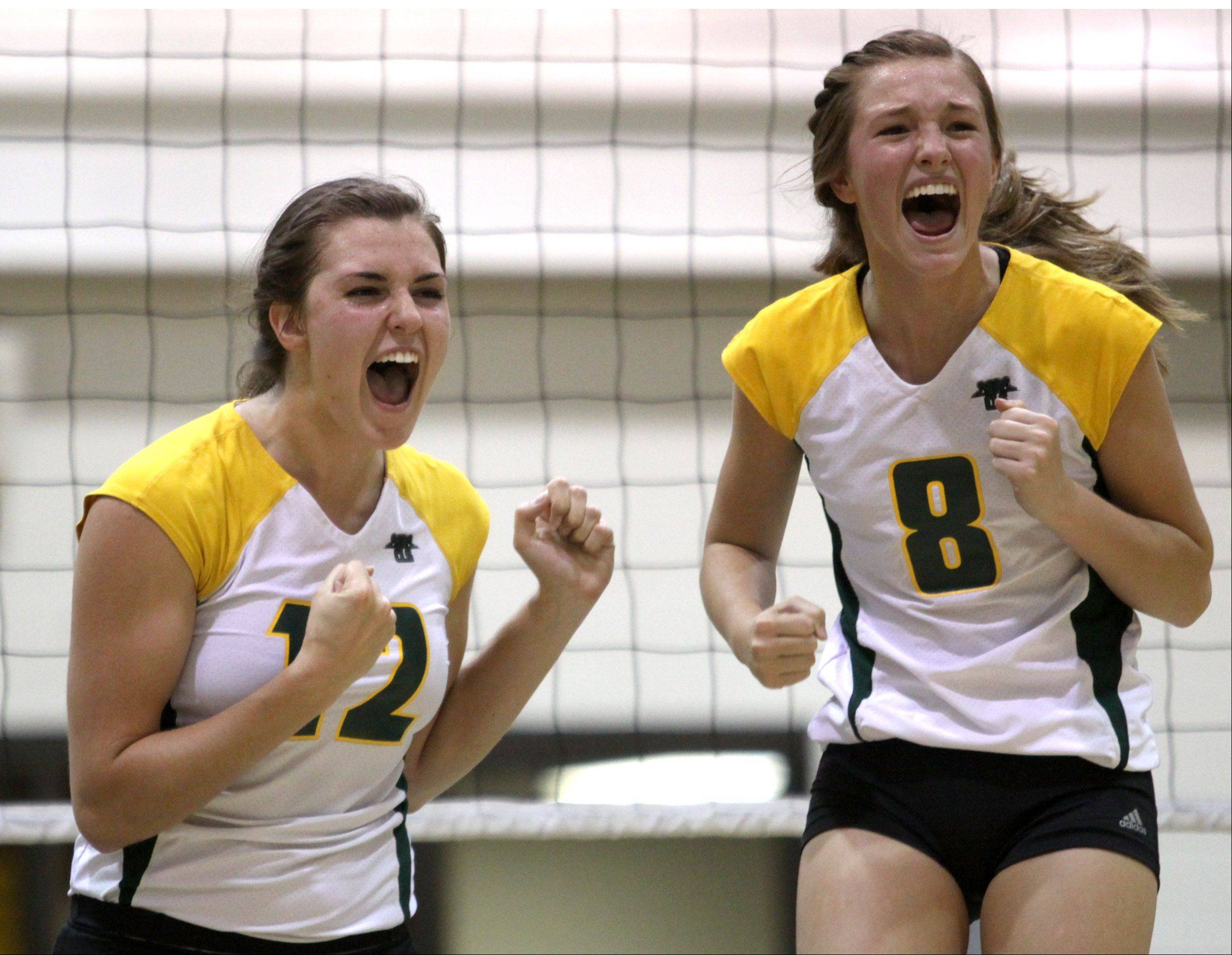 Crystal Lake South's Cassy Sivesind, right, and Nicole Slimko, left, celebrate a point in a win over Cary-Grove Thursday night in Crystal Lake.