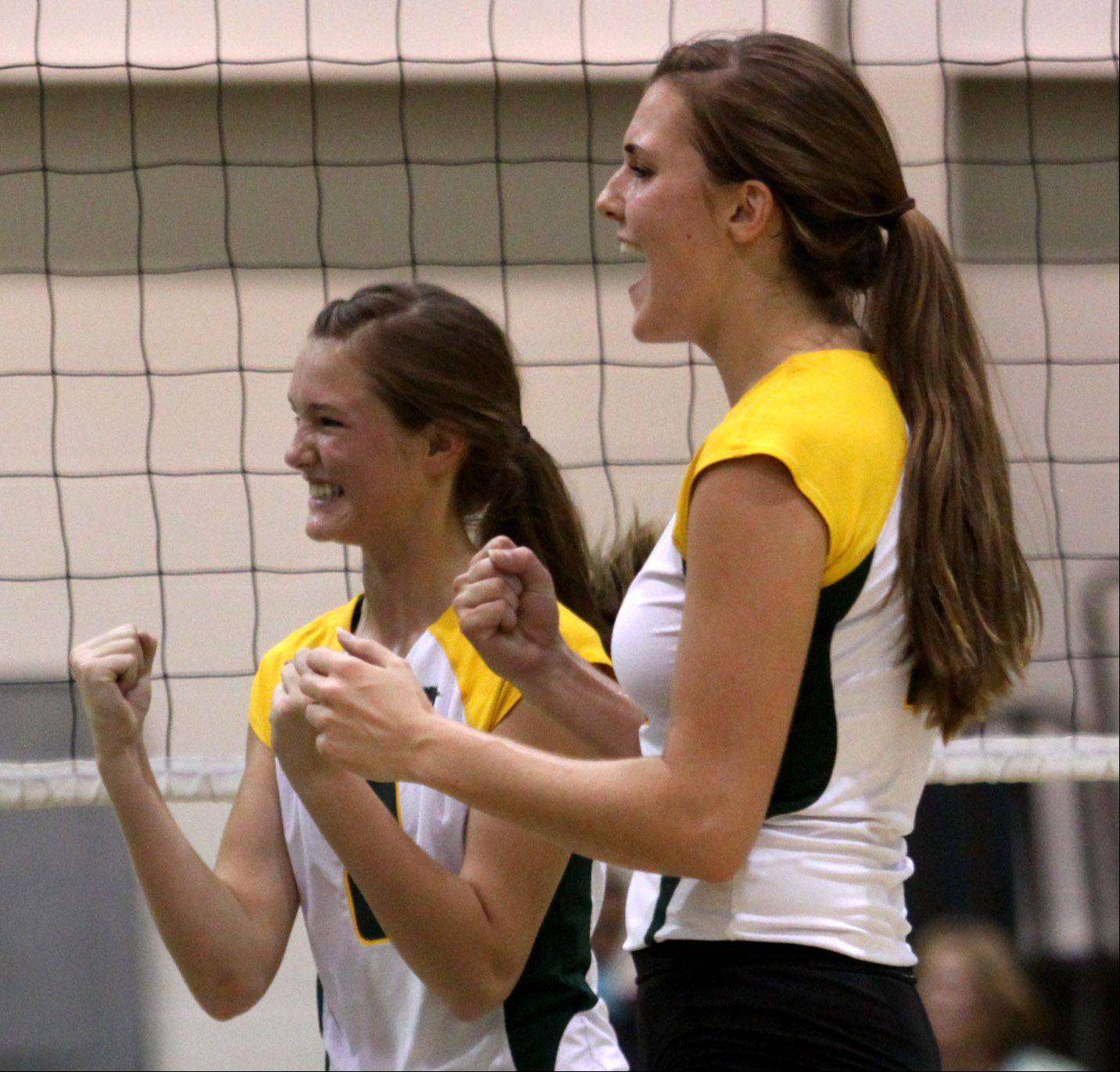 Crystal Lake South's Cassy Sivesind, left, and Nicole Slimko celebrate a point in a win over Cary-Grove Thursday night in Crystal Lake.