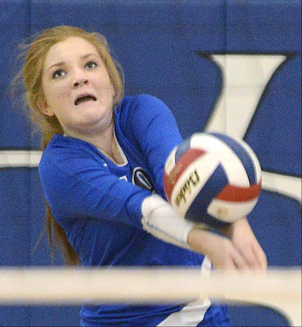 Geneva's Hannah Lanasa catches a back row serve against Dekalb Thursday in Geneva.